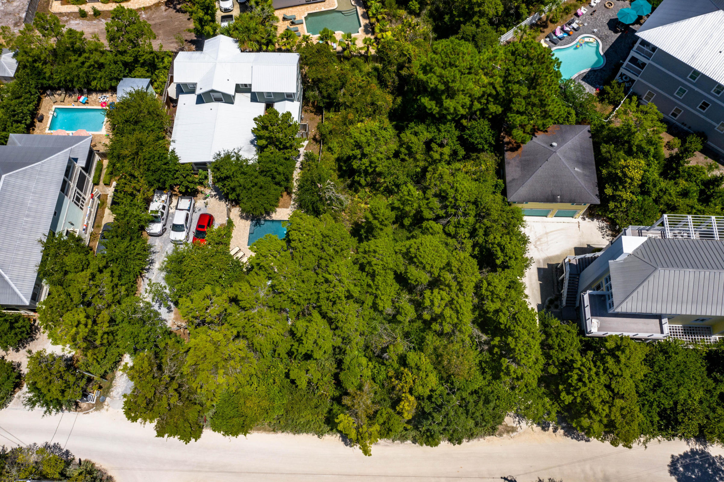 Oversized lot, 4 doors from Seaside. An exceptional opportunity to build a Seagrove dream house. Very few vacant lots remain in the wooded and desirable Seagrove neighborhood. No HOA dues, while very convenient to the popular shops and restaurants of nearby communities. There is nothing like a new home near the heart of 30A. At 67'x150', this lot yields nearly a quarter acre of space. The property will hold a large rental home, or a legacy beach house with all the amenities 30A beachgoers have come to demand. The maturely wooded lot also gives you the option to build for privacy, should you desire.