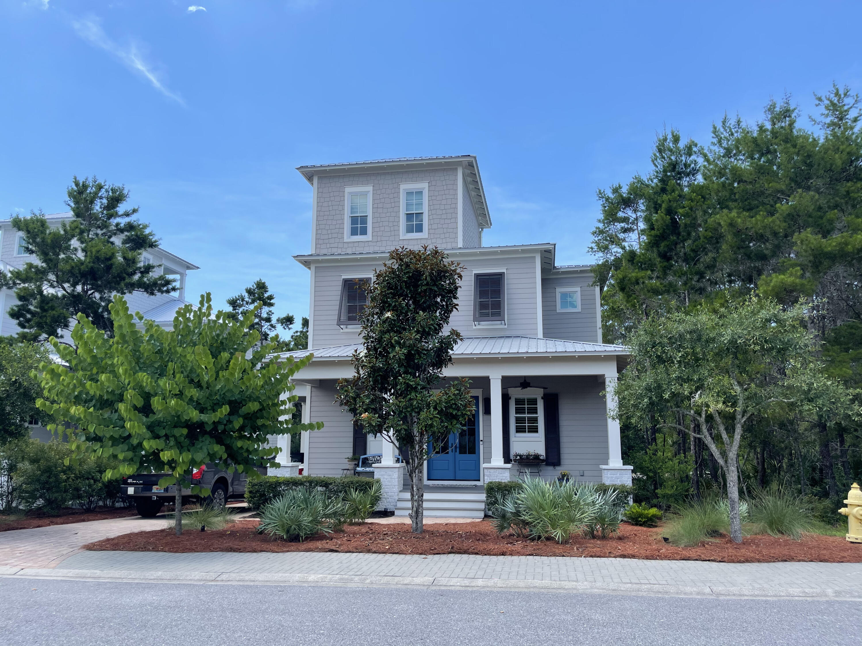 Another beautiful home in The Preserve at Grayton Beach.  Fully furnished w few exceptions. A custom home with hardwood flooring throughout with exception to carpet in the guest bedrooms & tiled bathrooms & 3rd floor tower room with wet-bar.  Entering into the home, this open floor plan with custom built-in wall unit, shiplap accent wall, solid wood doors,  custom cabinets throughout, gourmet kitchen with gas cooktop, separate wall unit for oven (could be used as a double oven) and wall unit microwave.  Kitchen counter tops & separate island are quartz as well as all the bathroom vanities.  The first floor has a master suite with sitting area, walk-in tiled surround shower, separate water closet and double vanity, laundry room with sink, 1/2 bath and a screened-in porch with gas fireplace An under the stairs closet, could be used as an owner's closet.  Walking up to the second floor, there is a large landing that could be converted into a bunk room. There are two guest bedrooms with with their own bathroom.  One of the bathrooms has a tub/shower combination with double vanity and the other bathroom has a walk-in shower with double vanity. Each bedroom has a door going out to the deck with a glimmer of the Gulf of Mexico.  Going up to the 3rd floor tower,  there is a 1/2 bath and wet-bar and an open deck with gulf views.  As you walk along the brick paved path on the east side of the home, there is an under the house storage area for your personal items and as you walk to the back of the house, a brick paved patio with a grill.  There is a gas rinnai for continuous hot water, a gas cooktop and gas fireplace.  So much detail in this beautiful custom built home.
