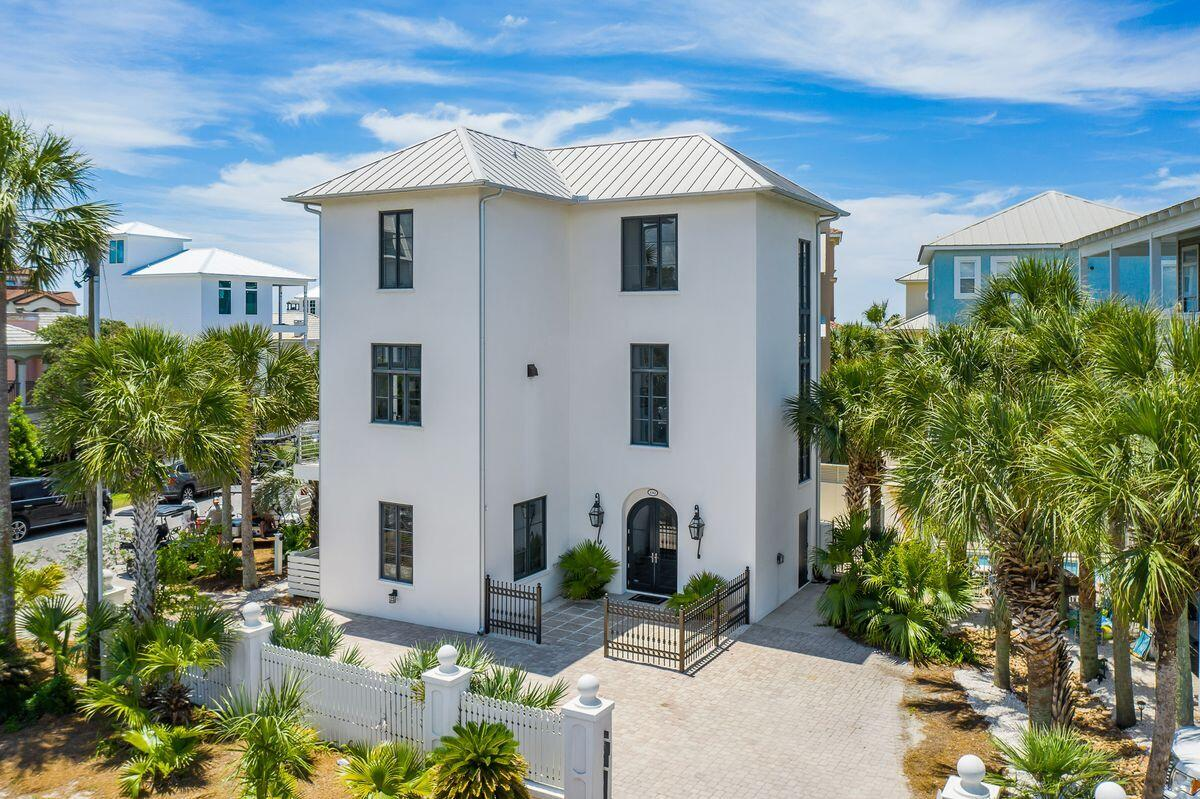 Endless memories and enchanting views abound from this ideally located three story beach home nestle