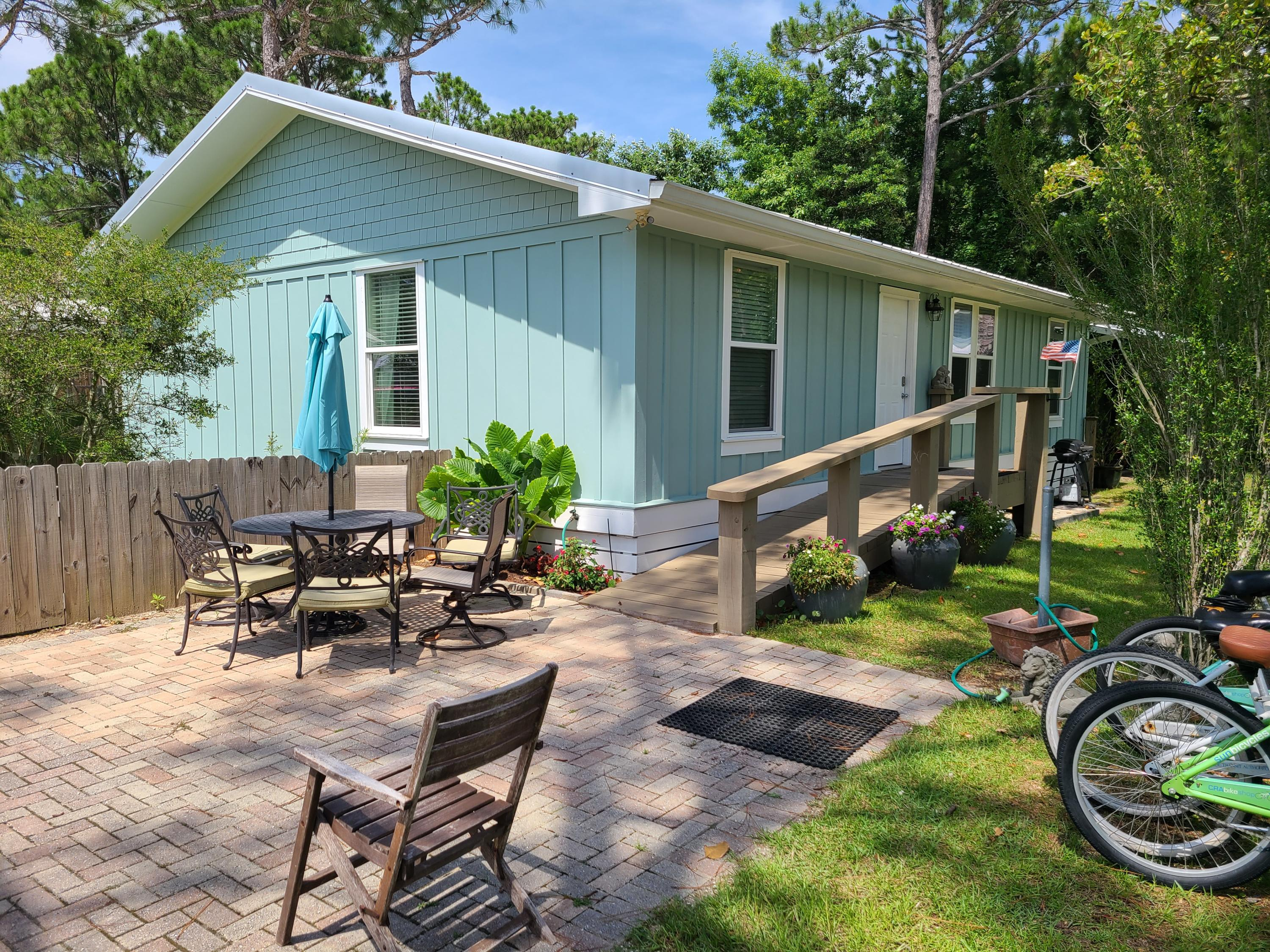Fully furnished, rental ready, this 3 bed, 2 bath home in Seagrove is on a large lot with room to ad