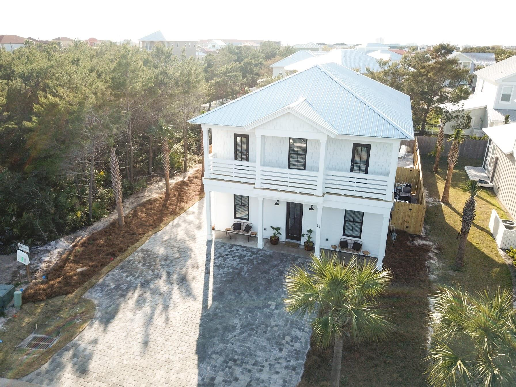 Nestled in the beautiful community of Frangista Beach with private deeded beach access, this brand new home is sold fully furnished with master on main. A rental machine that's already boasting $180,699 as the gross income total on the books for 2021. And $129,868.15 as the base rental rate total on the books for 2021, & can comfortably sleep 20 people! This spacious 2-story, 6-bedroom, 6.5-bathroom vacation home features a private heated pool for your enjoyment.