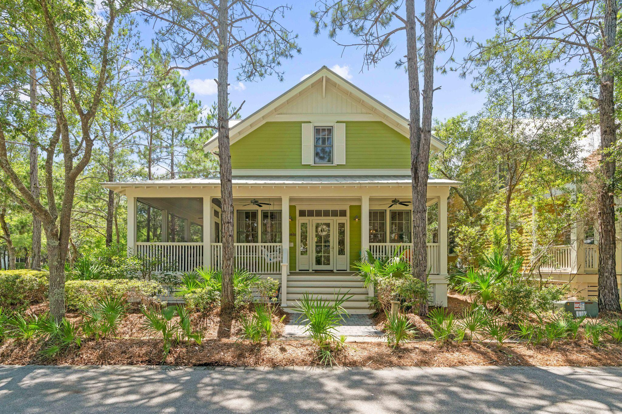 This 5 bedroom Beach House is tucked away on a corner lot in phase 3 of Watercolor.  The home has a large wrap around porch which is partially screened to enjoy summer days after a day at the beach or pool! The home offers an open floor plan allowing for great family time and entertaining.  The home offers wood flooring throughout and white shiplap walls. The kitchen offers a center island, kitchen aid stainless steel appliances to include refrigerator with icemaker, gas range, exhaust hood, dishwasher and microwave, an abundance of both counter and cupboard space and overhead transom cabinets that adorn the breakfast bar.  Decorative beach color backsplash fits perfectly in this Watercolor beach house.  This home offers the must have large pantry with wooden shelving.  Just down the hall is a very practical utility room complete with washer, dryer, utility sink and shelving. This home has a first floor master bedroom beautifully done with a whitewashed shiplap accent wall, large closet and a master bath with transom windows making it so light and bright! The bath offers a double vanity, garden bathtub with a beautiful shell chandelier, stand alone shower and water closet. A bunkroom and full bath complete the first floor. The second floor offers a large hall closet and two additional bedrooms.  One has an ensuite and one has a bonus bunk area with a full bath just across the hall. This property has a two car garage with a spacious carriage house above with a separate entrance. The carriage house not only has an oversized bedroom area, but a kitchenette area with a mini frig and a sink. A gorgeous white barn door slides open to the large bathroom with wall cubbies and a stand alone shower.  The perfect mother in law suite! The back porch of the home has a large storage closet and steps down to a large paver patio courtyard with an outdoor fireplace, grilling/kitchen area, al fresco dining and is covered by a beautiful white pergola. Tall Timber Court is a loop off o