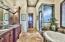 Master bathroom with huge walk in closet, sunken tub and steam shower