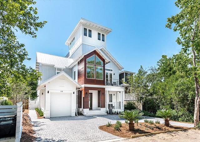 Tucked into the tree lined terrain of Old Seagrove, this incredible new build is a coastal contemporary home with incredible unique, retro, eye-catching amenities and extras and no HOA! 1st Floor offers 1 master suite and 2 additional king suites, a Game Room with sitting area kitchenette flowing to a beautiful outdoor private pool and yard. The 2nd Floor offers a second master bedroom suite and 1 additional king suite, the main living area with fireplace, a Professional Kitchen with Thermador appliances and glass accordion doors leading to the screened in balcony with outdoor dining table and cushioned sitting area Kids Floor is on the 3rd level which is accessed via spiral staircase or elevator, 2 Bunk Suites. 4th floor tower room offers a sitting area a large rooftop deck and hot tub.