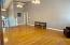 Large living room with 13 ft ceilings and wood floors