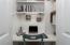 Custom built in desk area in master dressing area