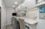 Laundry area with quartzite counter and lots of storage. Washer/Dryer do not convey