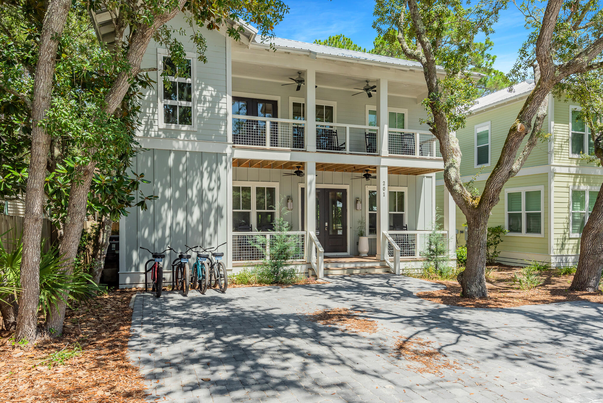 Charming quintessential Grayton Beach abode offering everything that encompasses the Grayton lifestyle.  Craftsman architecture showcasing custom trim-work, walnut flooring, wood shiplap accent walls and quartz countertops exemplify this 30A property. 201 Defuniak Street features 4 bedrooms, 3 full bathrooms, 1 half bathroom, a private pool and outstanding outdoor living. Enjoy relaxing afternoons on one of the many porches found on the home. Situated in the heart of 30A and steps to the sugar-white sands; luxury dining, high-end shopping and world-class entertainment is a walk away. Offered fully furnished, this cottage creates the perfect second home, permanent residence or investment property.  Opportunities in Grayton are rare, do not miss the chance to make this your paradise!