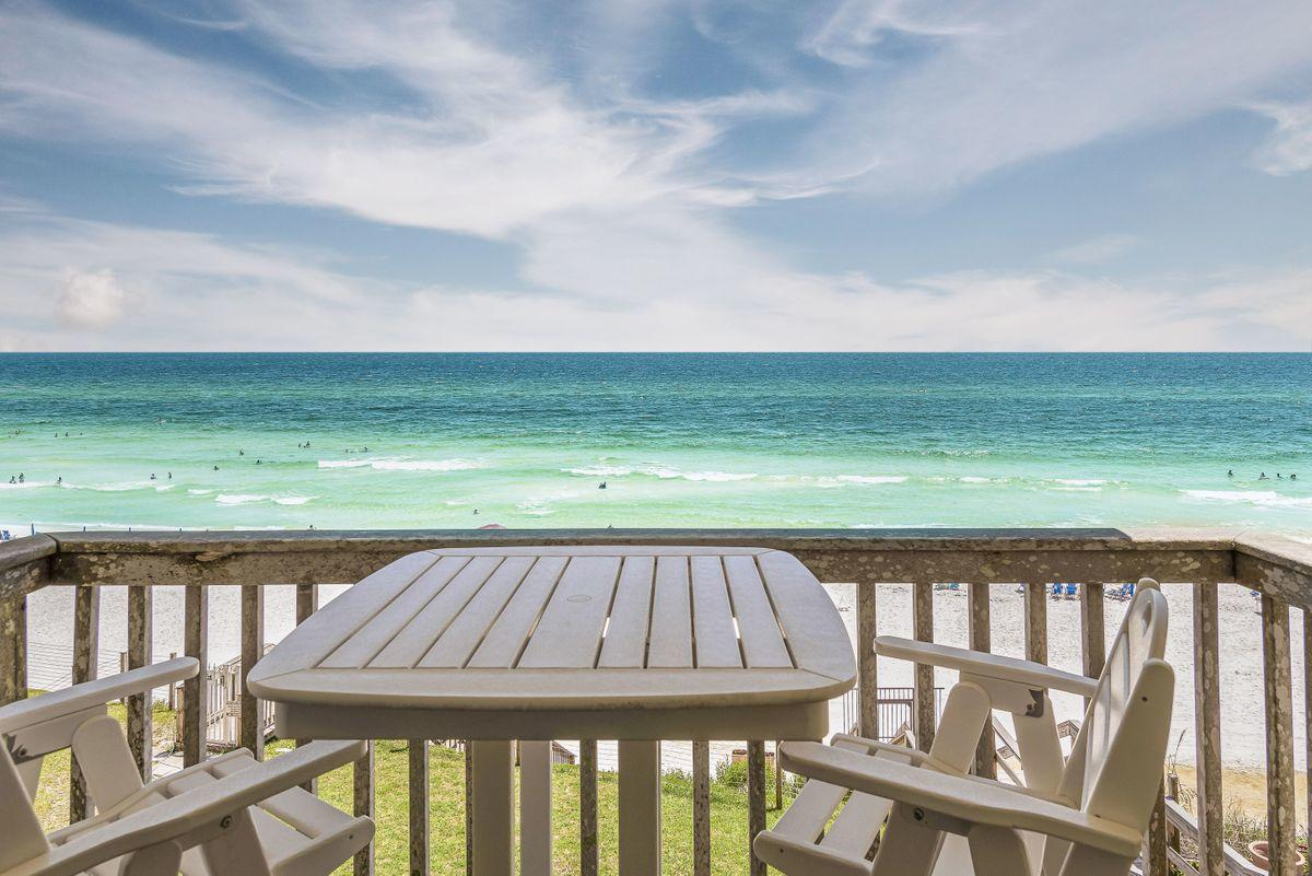 Nestled on the beach in Blue Mountain is this quaint 10-unit condominium with a grass yard directly on the Gulf of Mexico! A third floor updated beach retreat with 2 bedrooms & 2 baths, the low density immediately relaxes you! Well-located for a short stroll to Blue Mountain Bakery, Blue Mabel, the local health food store or ice cream shop or a couple of local pubs, you'll love not having to get into your car! There is lots of storage space in the community storage rooms for the 10 owners. HOA fees are only $500/month! Most of the owners have owned here for years.