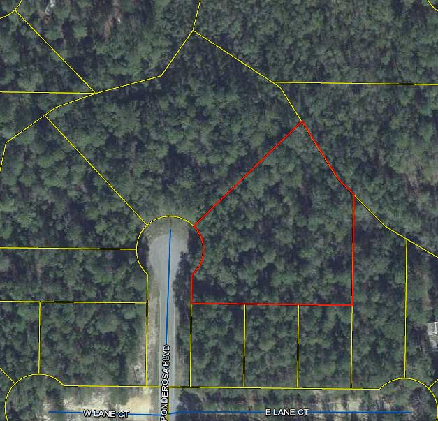 This is an excellent opportunity to purchase a large lot at the end of a quiet street.  Measuring over 2/3 acre this lot is located at the end of a cul de sac featuring a paved road.  Priced to sell.  Call today!