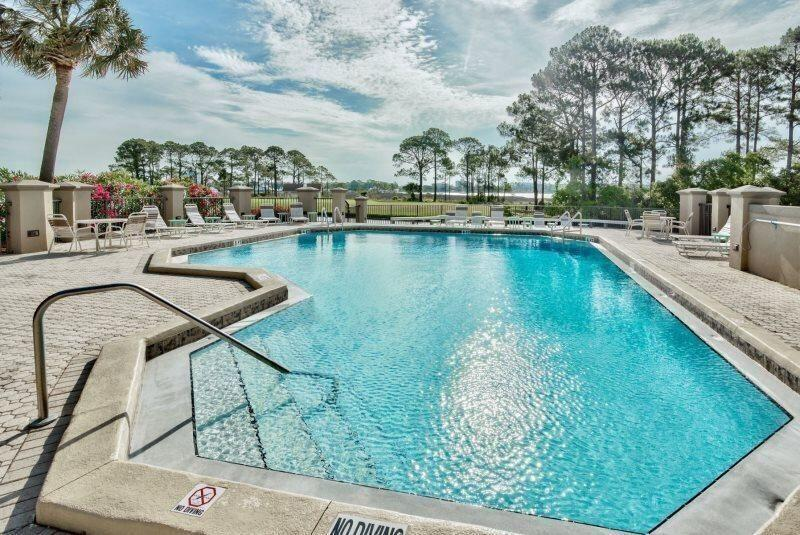 Adorable rental machine over looking Choctawhatchee Bay, the Marina, Village of Baytowne Wharf, and the Links signature hole #14! Located within Sandestin Golf and Beach Resort and perfectly poised to enjoy weekly fireworks display, sunrises each morning and views galore! This fabulous condo is being offered fully furnished with newer pillow top mattress, gun metal non-finger print appliances and coastal chic furnishings! Check out VRBO # 1119776 to see more photos