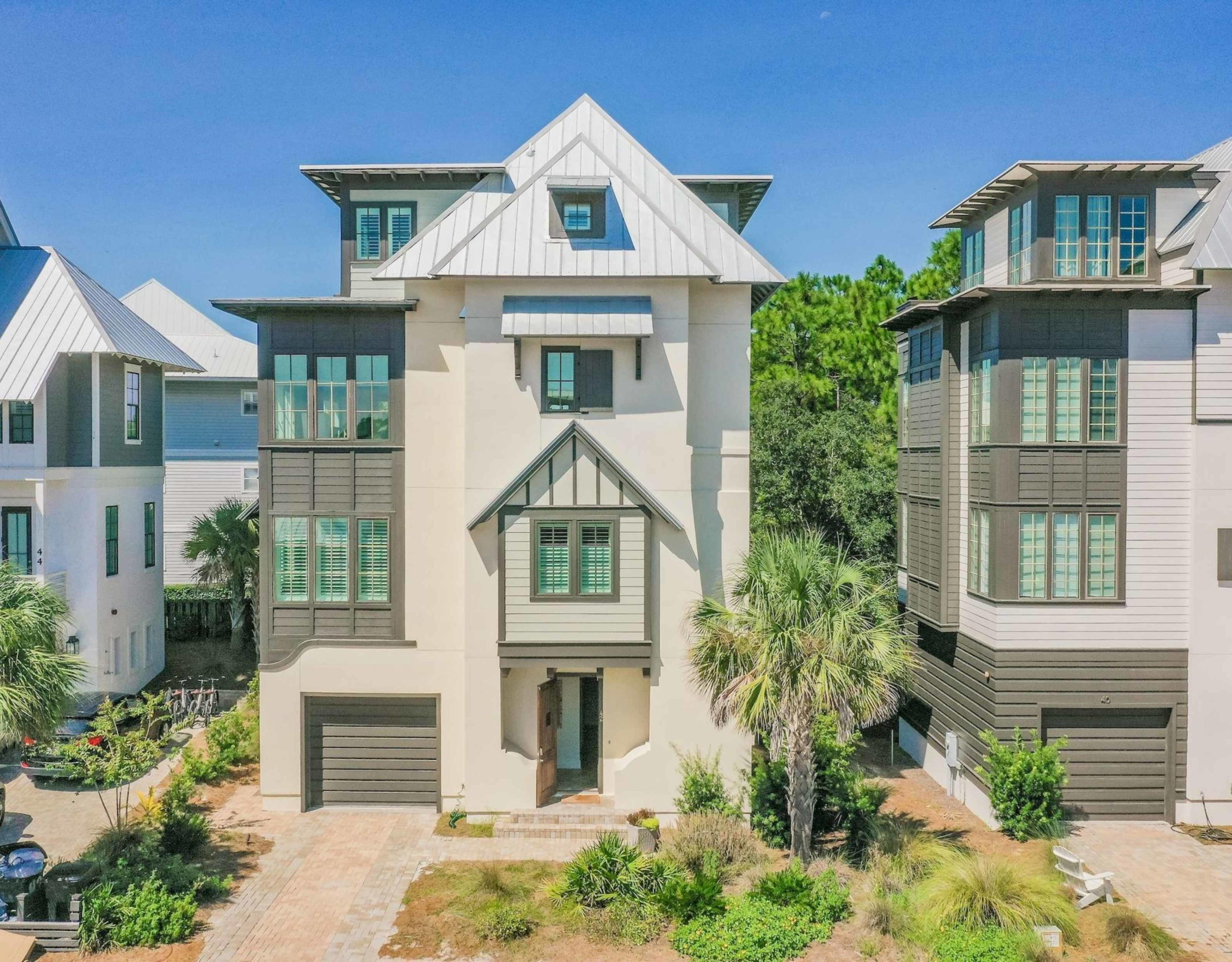 This generously appointed and well-decorated 5 brm/4.5 bath beach home is located south of 30A in the quaint community of Tresca Place in Seagrove Beach. You're just steps away from the community pool and a short walk from the beautiful Gulf of Mexico beaches. This area of Seagrove allows for quiet enjoyment and relaxation at the beach, as well as close proximity to the dining and entertainment of Rosemary Beach and Seaside. Built in 2015, the home features hardwood floors throughout, SONOS home sound system, an elevator that travels to all floors, and gorgeous modern finishes. The home is professionally decorated with coastal inspired decor and furnishings. Relax in the open concept living/dining area on the third floor with over-sized windows looking at the surrounding community.