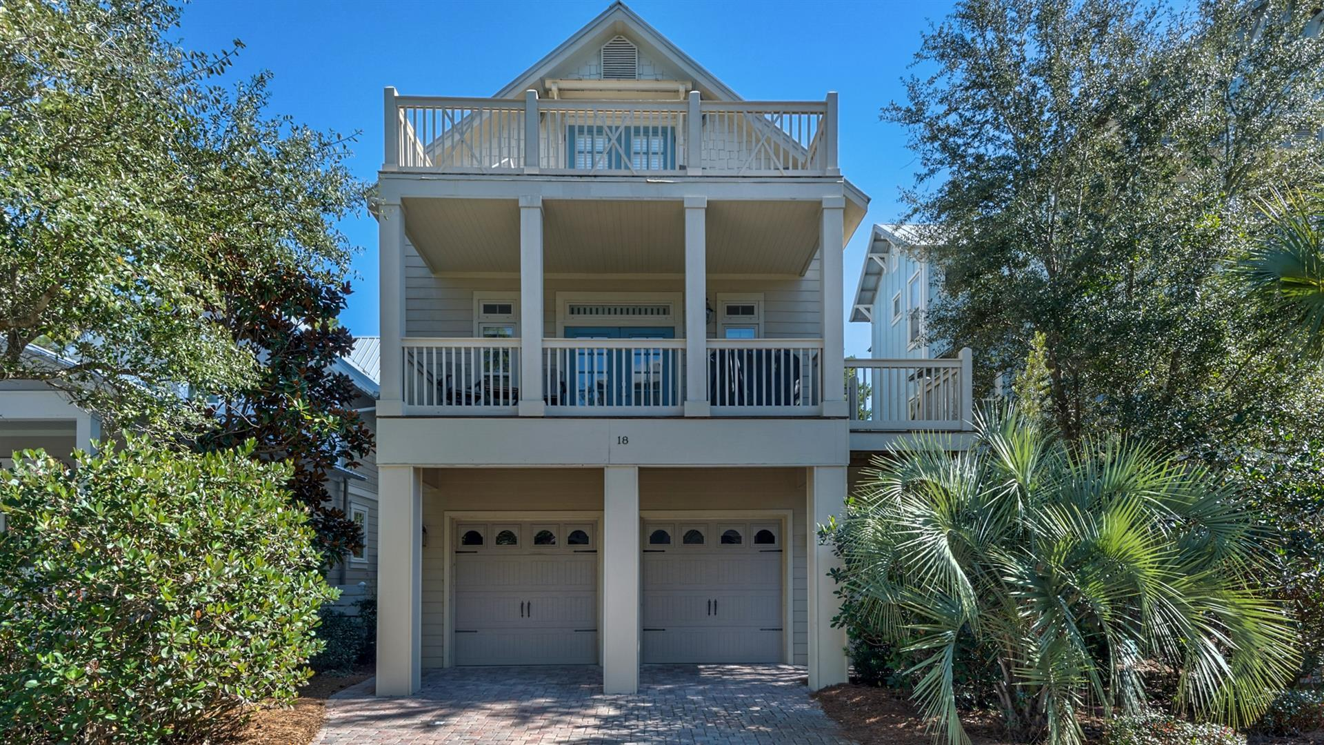 Beautiful home located south of 30A in the quiet  community of Cottages at Eastern Lake, this 4BR/3.5BA home is perfectly suited as a full-time residence, second home or as a rental property.  Highlights of this home are two large private porches, oversized 4 car garage with additional room for a golf cart (currently equipped as a game room with ping-pong table and pool table), four spacious bedrooms, stainless appliances, crown molding, and large welcoming living area.  Fresh paint, new flooring throughout home.  New furniture in all the bedrooms, new shiplap on the stairs. The Cottages at Eastern Lake sits adjacent to Watersound West Beach and features palm tree lined brick paved roads and a resort style community pool.  Just a short bike ride to the beach, shops and restaurant