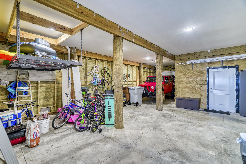 HUGE GARAGE WITH BUILD IN STORAGE ROOMS