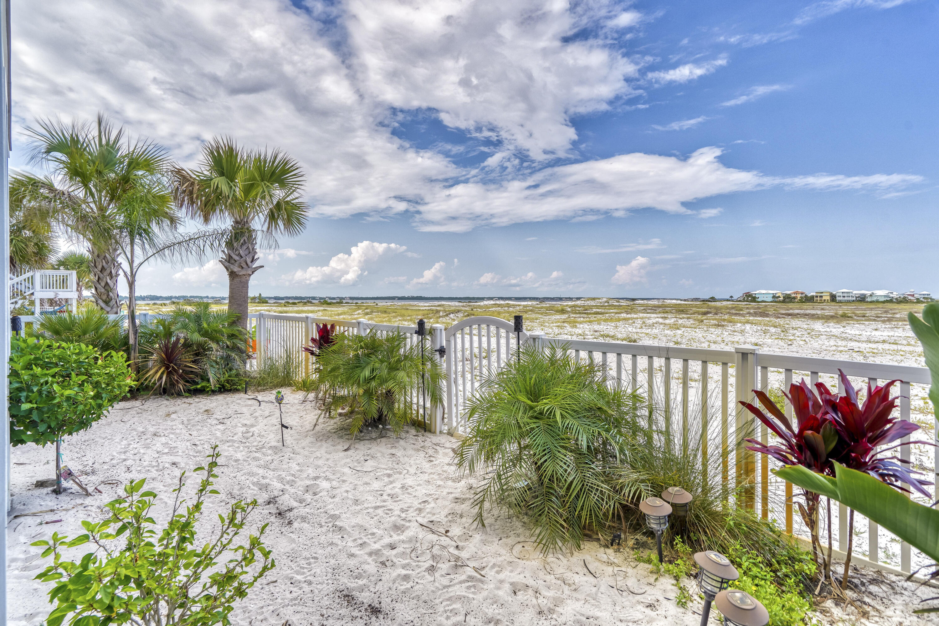 BACK YARD OPENS TO COUNTY BEACH LAND
