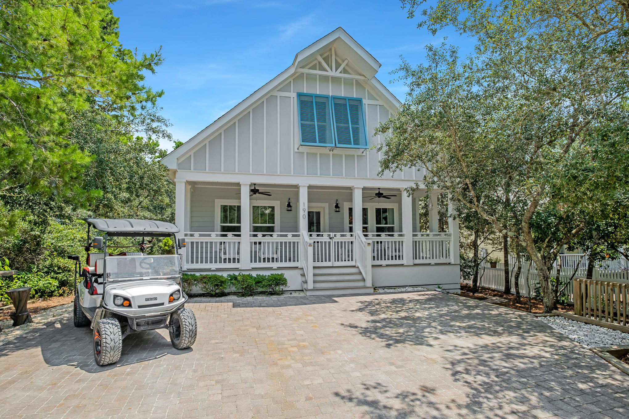 Perfectly positioned South of 30A, this quintessential beach house resides in Seagrove Beach minutes away from the white sugar sand beaches and all of the iconic town centers found along 30A. Constructed in 2015, the like-new residence encompasses over 2,100 square feet of thoughtfully designed living space spanning two levels. Upon initial approach, the deep front porch leads into the living and dining areas adorned with shiplap accents, beamed ceilings, and oak flooring. The coastal flair is carried through the Chef's kitchen complete with a luxury appliance suite, ample cabinetry, and a built-in nugget ice maker. Synonymous with relaxation, the backyard oasis with heated pool is bordered with lush vegetation and towering bamboo providing the utmost privacy. Overflowing with natural light, the oversized first-floor main suite boasts a shiplap accent wall and ensuite with antiqued vanity, water closet, custom tiled shower, soaking tub, and large walk-in closet. An additional bedroom, full bathroom, laundry room, and mudroom are also found on the first level.   Currently configured as a bunk area with sleeping accommodations for four, the second level common area provides access to the two additional bedrooms and bathroom suite with dual sink and water closet configuration.  Poised less than 0.3 miles away, the nearby Eastern Lake Neighborhood Beach Access overlooks the rare Coastal Dune Lake while providing beachgoers with amenities like a wash-off station, bike rack, and parking accommodations. The pristine condition and turn-key configuration coupled with the impressive rental potential make 190 Dalton Drive a compelling opportunity for investors and full-time residents alike. Inquire today to start living the coastal lifestyle you deserve.