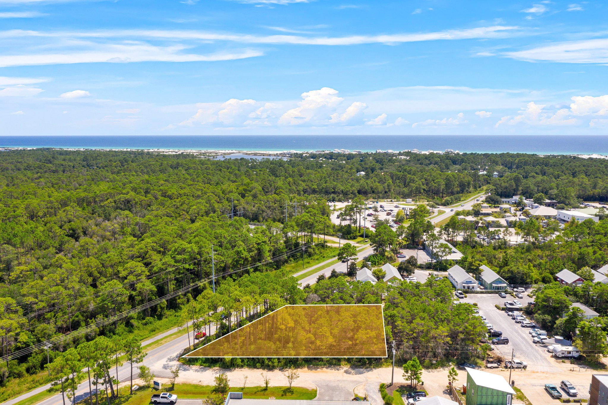 Prime Commercial Real Estate with over 1/2 an acre along HWY 283 in Grayton Beach. Land is being sold with a full Development Order from Walton County in place. Engineering plans, surveys and all documents convey with the sale