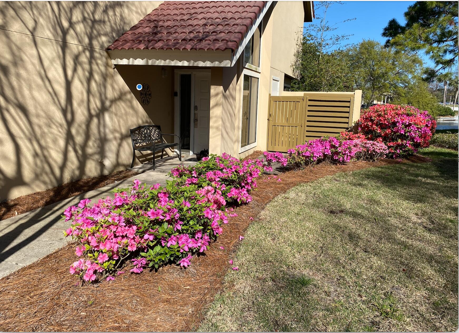 Rental numbers are off the chart with $65,000 in yearly gross rental income.  Unique and very desirable location.  Rarely do these 2/2 become available with bunk room and two master suites....one on the main level, with private covered patio.   Condo is open, spacious and flooded with light.  Relax on your back patio overlooking the lake or take advantage of the conveniently located neighborhood pool.  Nicely updated with huge attic and rental ready....fully furnished with GOLF CART INCLUDED!!!!