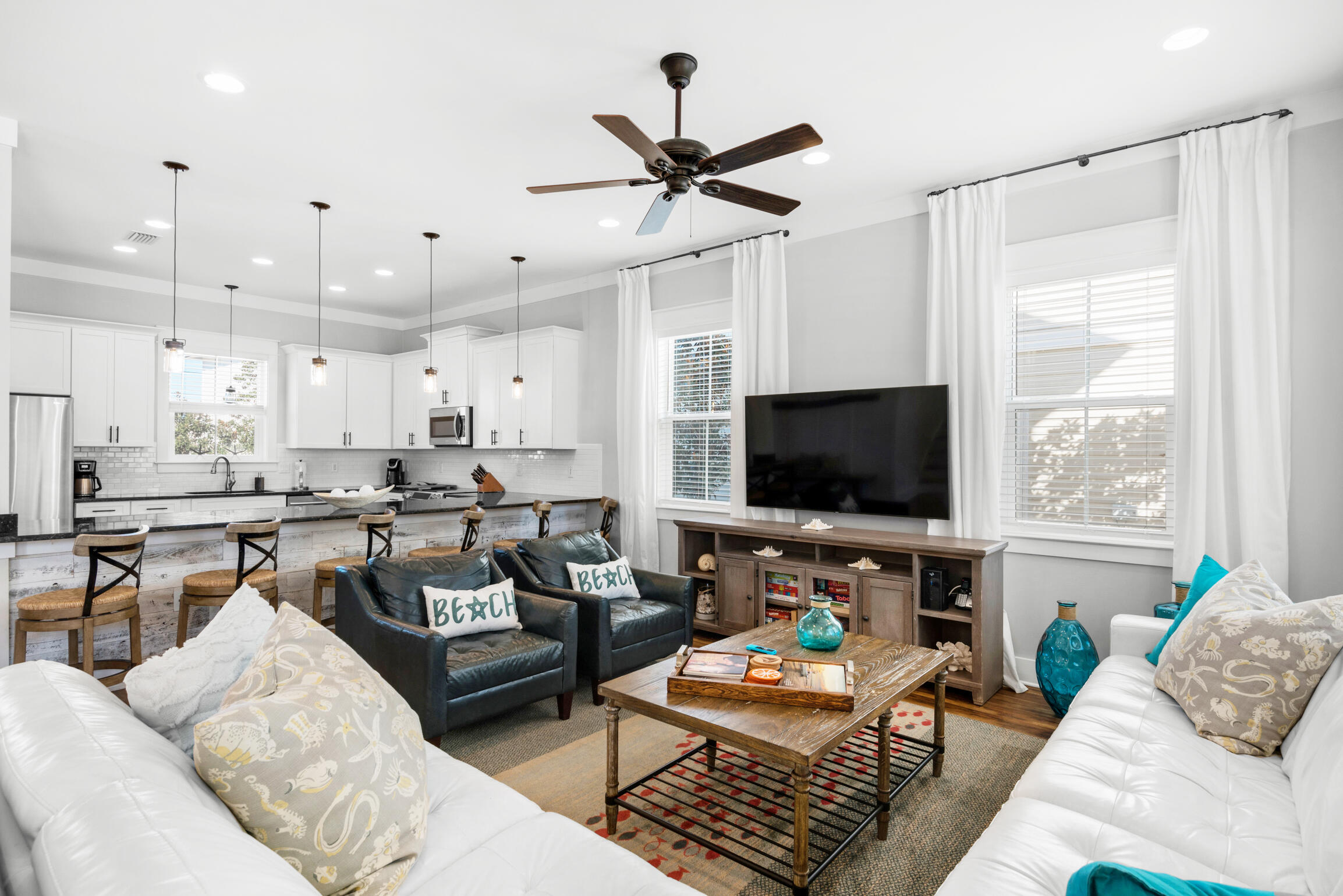 This exceptional Magnolia Dune home in Seagrove has it all! Built in 2015 and backing up to the community pool, this four bedroom (plus a bonus bunk room) home is the perfect spot for a 30A beach getaway. Park your vehicles in the large driveway and leave them there as 55 Sandalwood Drive is only a 0.2 mile walk away from the closest of two beach accesses as well as restaurants like 30A Cafe, Angelina's, and the Donut Hut. Upon entering the home guests will notice the large open floor plan layout of the kitchen, living, and dining areas. The dining table has seating for ten with additional seating for six at the large kitchen counter. The thoughtfully appointed furnishings in the living area make it a great place to unwind and relax after a long day at the beach while the chef's kitchen offers ample counter and storage space for the cook in your party. The first floor also features a laundry room with twin stacked washer/dryer units, owner's lockout closet (one on all three floors of the home), a half bathroom, and access off of the kitchen to the rear deck and outdoor dining area which is conveniently located adjacent to the beautiful community pool.  The master bedroom and two guest bedrooms are located on the second floor of the home. Each bedroom has its own ensuite bath and both the master and the eastern guest bedroom have direct access to the large shared second floor balcony.   The third floor consists of the fourth bedroom with two twin over twin trundle beds and a bonus bunk area - both share the full bath via Jack and Jill access. The third floor balcony is a great place for morning coffee or an evening cocktail as one can catch a glimpse of the emerald green water of the Gulf of Mexico.  55 Sandalwood Drive is the ideal blend of comfort and convenience and a perfect choice for a second home or rental property located right in the heart of 30A in Seagrove.