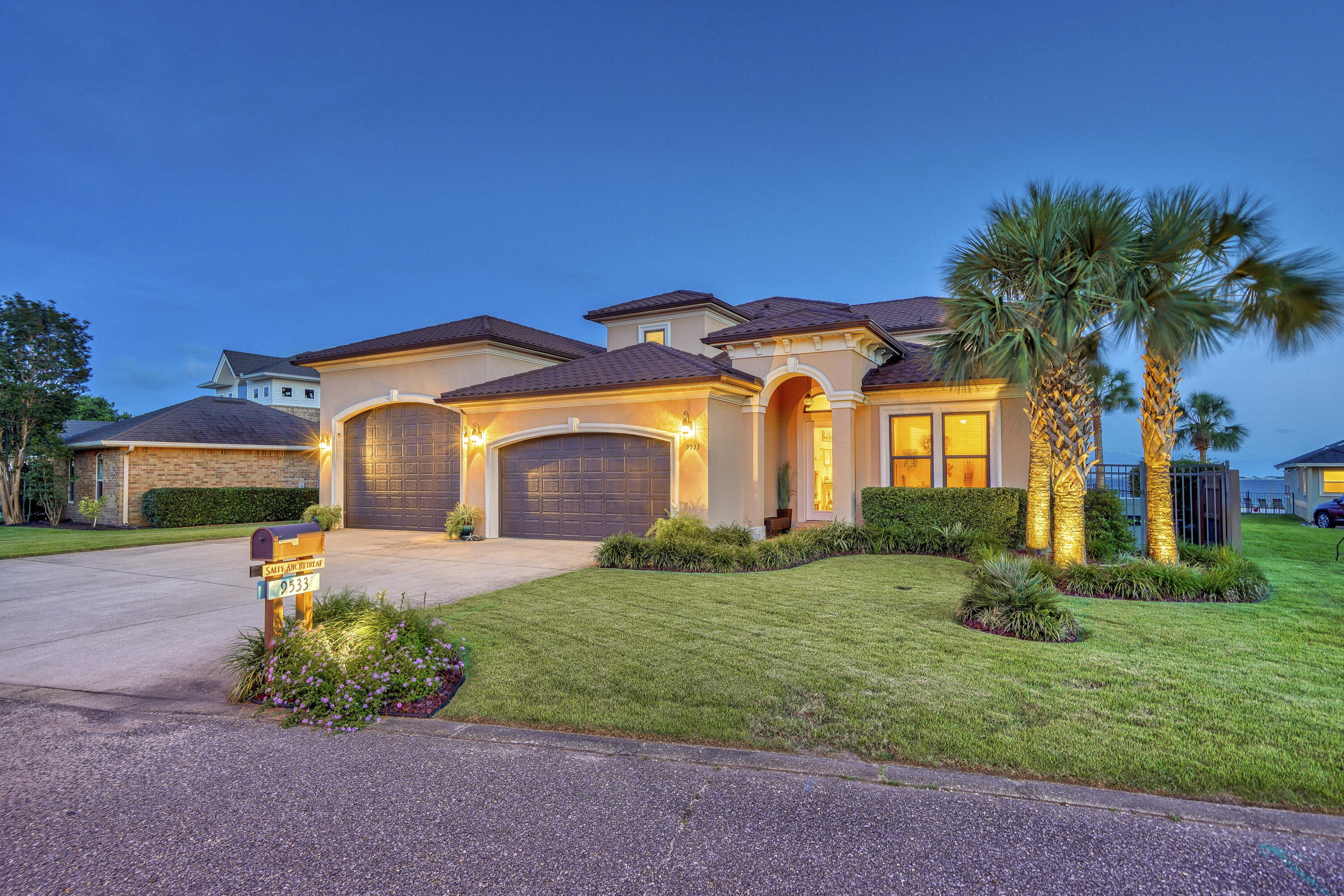 AMAZING WATERFRONT 2016 Custom Home with 4 Bedrooms, 2.5 Bathrooms, Office, Loft Area, and Bonus Room. Huge .61 Acre Sound Front Lot with 115 Feet of Prime Santa Rosa Sound Water Frontage, Boasting 3126 Sq Ft of Heated & Cooled Living Space and a Total Space Under the Roof of 5568 Sq Ft! This Incredible Home is Equipped with a 3 Car Garage AND an Almost 1K Sq Ft RV/Boat Garage with 16 Ft Ceilings AND is Located in FLOOD ZONE X, AND has a Whole Home Generator! Relax in the Back Yard Oasis Outfitted with a Large In-Ground GUNITE Pool, Deck, and Fountain, Ample Yard Space, and Jawdropping Water Views. Ever Dreamed of Having Everything you Want in a Home AND be on the Water? THIS IS IT! Upon Entering this Gorgeous and Immaculately Maintained Home, Notice the Fine Details Throughout.. More... such as Beautiful Wood-Look Tile Flooring, Crown Molding, Recessed Lighting, 10 Ft Smooth Ceilings, 8 Ft Doors, Modern Finishes, Fixtures, and Hardware, Open Floorplan with Tons of Natural Light and TREMENDOUS Water Views!  Step into the Kitchen and Find Plenty of Counterspace and Beautiful Cabinetry, Pantry, Thick & Gorgeous Quartzite Countertops, with Quartzite Topped Island, and Modern Conveniences such as Touch Kitchen Faucet.  The 1st Floor has a Dreamy Master Bedroom and Bathroom, both with Incredible Water Views and Tons of Natural Light. Inside the Master Bedroom are Tray Ceilings, Recessed Lighting, and Private Doors to the Back Deck & Pool. The Master Bath is Stunning, with Separate Stone Vanities, Large Walk-in Glass Shower, and Soaker Tub that Looks out to the Sound. The 2nd Floor has Three Bedrooms with a Loft Large Enough for a Second Living Room, as well as a Bonus Room. The Two South Rooms as well as Second Floor Deck have Incredible Panoramic Water Views. The Deck and Railing Material are Tile and Aluminum for Lower Maintenance Waterfront Living. Be Amazed as you Look over the Gorgeous Pool Oasis, the Large Back Yard, Sodded with Zoysia Grass, and Equipped with a Wi