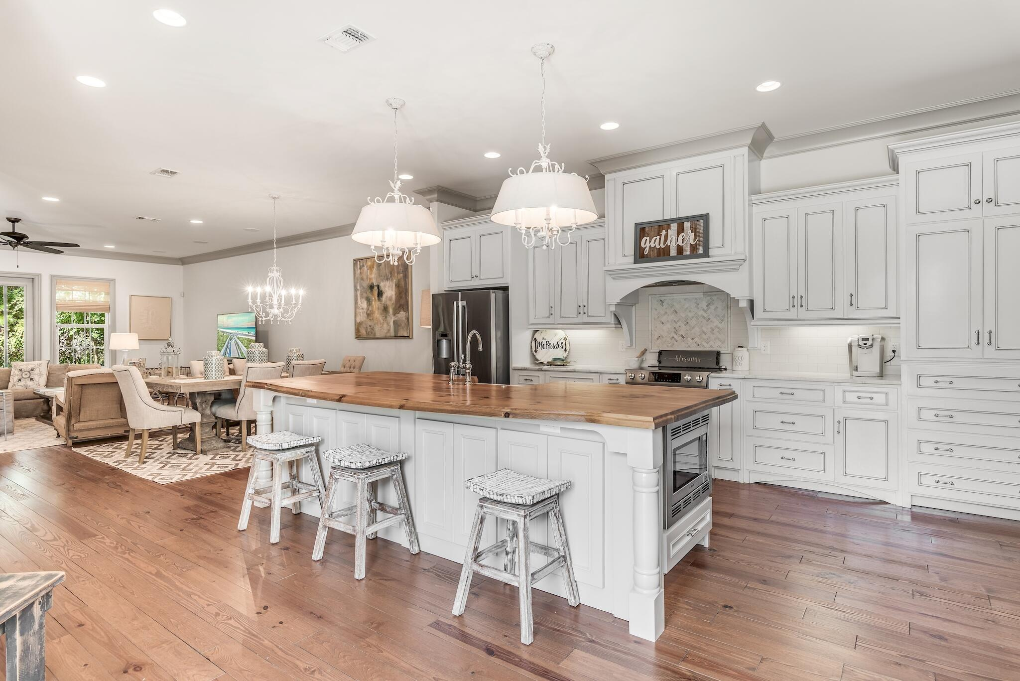 This Immaculate home was built by Legendary Home Builders in 2015. This is a one of a kind Villa that was custom built larger, with an open floor plan, bigger pool and full carriage house.  Destin Custom Home Builders takes prides in literally EVERY detail. This home has an exhaustive list of custom detail:Storm and Wind Impact Resistant Windows & Doors (150 Wind Loads)Insulated Garage DoorsFoam Spray Insulation in Roof for Superior Energy EfficiencyStainless Steel Screws, Nails, Flashing & StrapsFortified Gold Construction Inspection DesignationEnhanced savings on Homeowners' Insurance/YearTreated Plywood on Exterior WallsUpgraded Energy Smart WINK SystemsMonitor & Manage everything in your homeAll Showers have Schluter Waterproofing Specifically Designed to Maintain Integrity & Durability Custom Solid Wood Cabinets & Cabinet Doors All Interior walls insulated for Soundproofing Moisture Resistant Sheetrock used in all bathrooms Sound Insulated A/C systems Solid Core Interior Doors. The main house features 2 large bedrooms each with their own bathroom and generous walk-in closet space with custom shelving for an organized lifestyle. The study overlooks the courtyard and pool, which could easily be another bedroom or home office. The kitchen is open to the dining and great room and boasts 10 foot ceilings and lots of natural light. The design elements chosen by a professional designer include custom white cabinets, gorgeous white granite with hints of grey, solid wood flooring, and bathrooms decked out in the latest tile designs. The guest house is equipped with the same attention to detail as the main house and features a bedroom, bathroom, and full kitchen. This guest house can serve many different needs such as; a space for visiting friends and family or even a place for full time help to live. These are just a few of the things you can expect to see in this new home. I look forward to taking you on a tour.