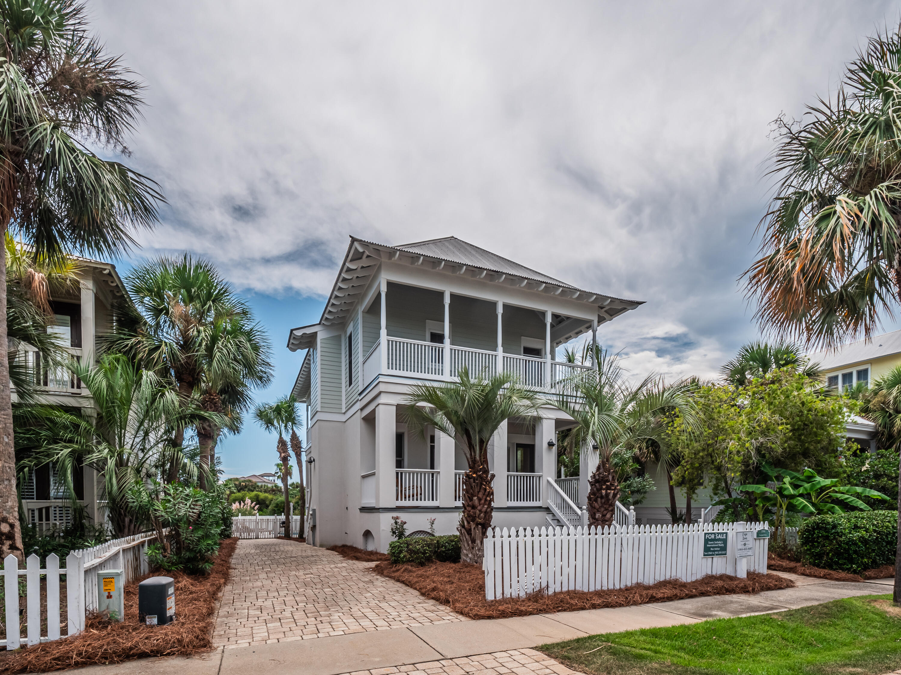 Under contract with a 24hr Kick Out Clause. Nestled into the quintessential resort community of Destin Point, this beautifully appointed four bedroom home offers a tranquil setting and unsurpassed amenities. Multiple levels of viewing decks gift both guests and residents with direct lake views, while quick access to the sugar sand beaches of Destin's East pass provides endless fun in the sun. Spaced over two levels with an oversized driveway for ample parking, Modern luxuries such as stainless appliances and slate countertops adorn the kitchen, providing an inspiring place for the culinary minded, while crisp wainscotting and a mesmerizing grid design ceiling in the living spaces offer custom touches sure to delight. A private lakefront pool offers an additional locale for relaxation and entertainment, perfect for sipping your evening cocktails while overlooking the crystalline community lake.   Located close to shopping and top area restaurants, this gated resort community near Destin Harbor provides an unparalleled ownership experience thanks to multiple community pools, tennis courts and a shuffleboard court.