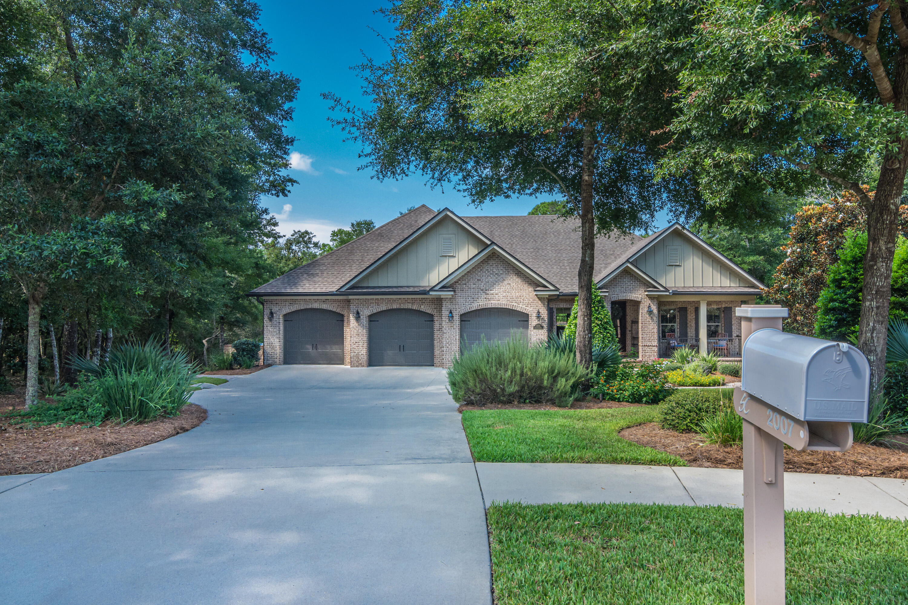 This stunning custom built home by Randy Wise is located on a private quiet cul-de-sac in the desirable Swift Creek neighborhood. If you are looking for tranquility and peacefulness, then this is the perfect home.  It boasts 4546 sq. ft. of high appointed finishes, surround sound, custom cabinetry, designer lighting, central vac, and hurricane impact windows in the dining area, master bedroom, and master bath. Added security provided by a built-in security system. Whole house Generac generator (with transferable 10-year warranty) installed in 2019 to automatically provide power for entire home. Master bedroom suite, two other bedrooms and office/study are located upstairs. Wood floors throughout most of upstairs, extra bedrooms have carpet.