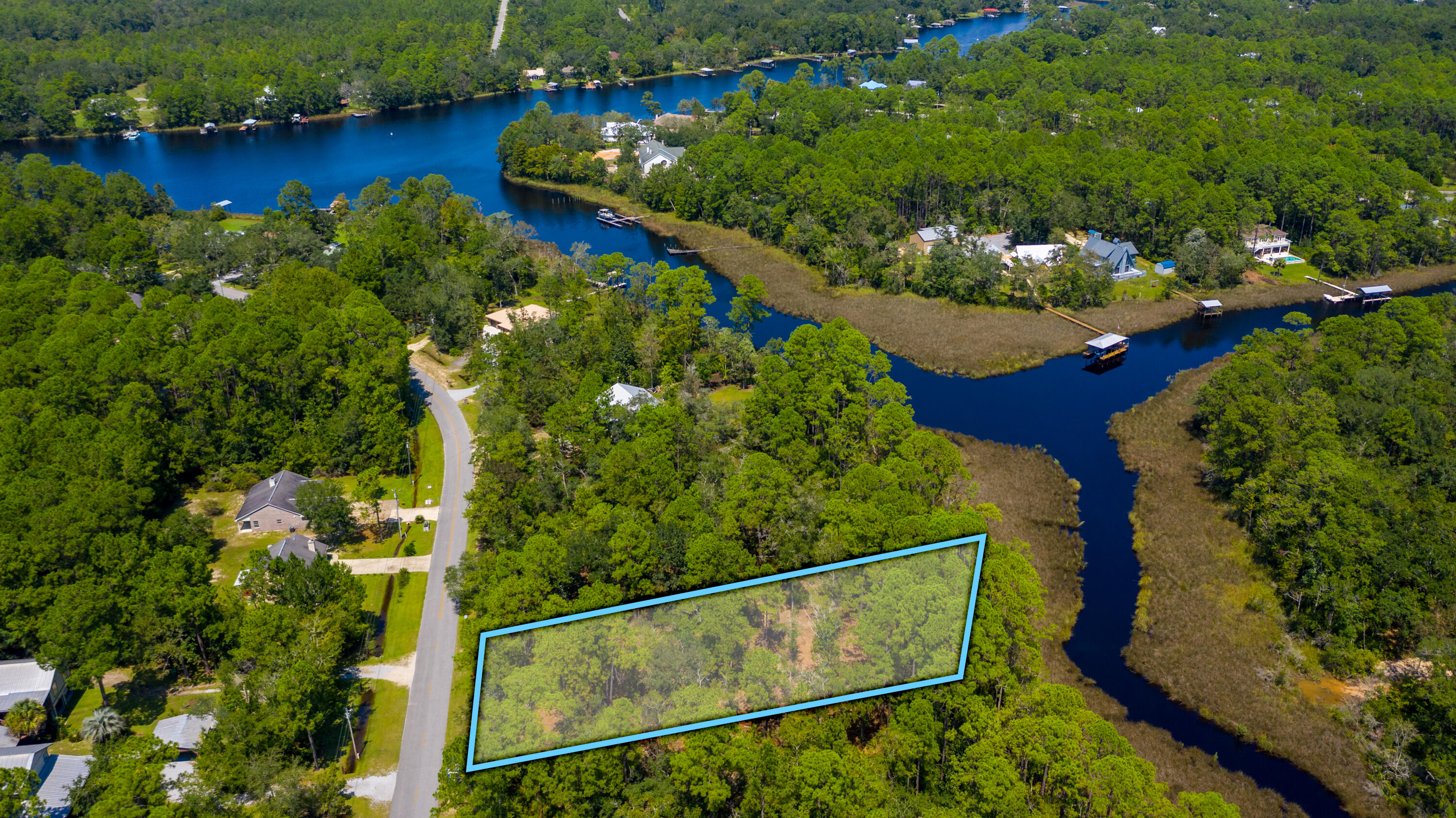 WATERFRONT LOT  Rare waterfront lot on Mallet Bayou with large space to build your dream home! There is a perfect mix of oak trees and pine trees throughout the property. 80+ feet of water frontage.  This lot is also in close proximity to U.S. Hwy 331 and the new county park/Boatramp.  Call to schedule your private showing.