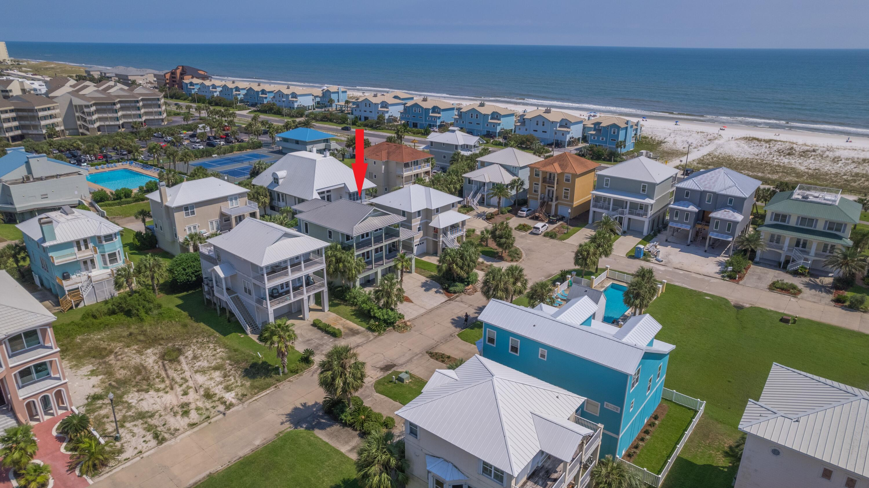 Located in the gated community of Deluna Point on Pensacola Beach, this home offers 3 separate covered balconies with impact windows, an open spacious floor plan with a large primary suite. This quiet neighborhood offers (no short term rentals) a community pool with a pier and deeded Sound access. You'll enjoy the high ceilings 10 foot throughout, travertine and hardwood flooring with surround sound and additional storage space in the garage. The main living floor has a bedroom with a full bathroom, oversized laundry room and 2 separate balconies. There are 2 covered balconies (39x9) on the front side of the house offering some water views from the third floor. With French doors opening from the living area to the spacious balcony, this space is ideal for entertaining guests or enjoying a Located in the gated community of Deluna Point on Pensacola Beach, this home offers 3 separate covered balconies with impact windows, an open spacious floor plan with a large primary suite. This quiet neighborhood offers (no short term rentals) a community pool with a pier and deeded Sound access. You'll enjoy the high ceilings 10 foot throughout, travertine and hardwood flooring with surround sound and additional storage space in the garage. The main living floor has a bedroom with a full bathroom, oversized laundry room and 2 separate balconies. There are 2 covered balconies (39x9) on the front side of the house offering some water views from the third floor. With French doors opening from the living area to the spacious balcony, this space is ideal for entertaining guests or enjoying a peaceful sunset. The primary suite also offers a private balcony on the third floor and a spacious bathroom with a double stone top vanity, jetted tub, separate custom tile walk-in shower with dual shower heads, water closet, linen closet and walk-in closet with custom shelving. Other notables are BRAND NEW HVAC unit upstairs, metal roof, Levolor blinds throughout, wine fridge, Viking refrigerator