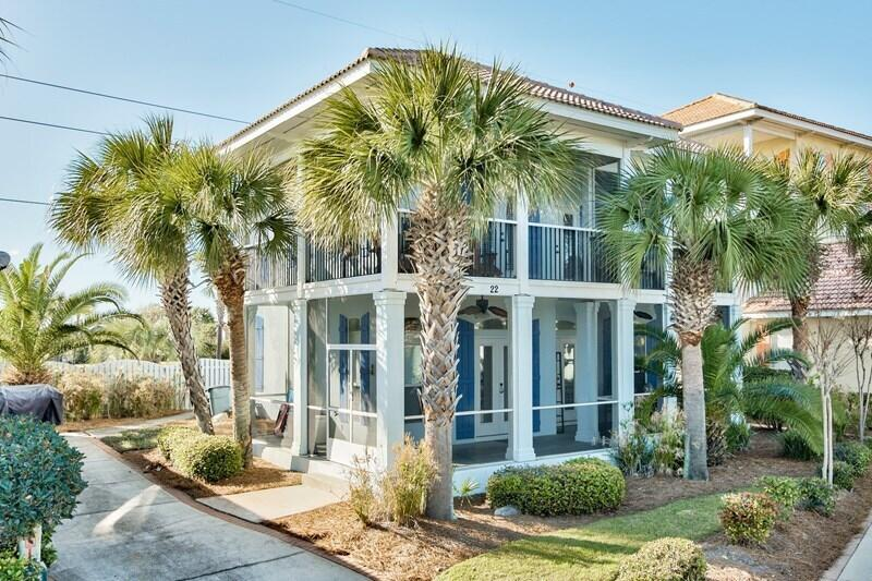This beautiful beach house has screened wrap around porches on the first and second floor. Large kit