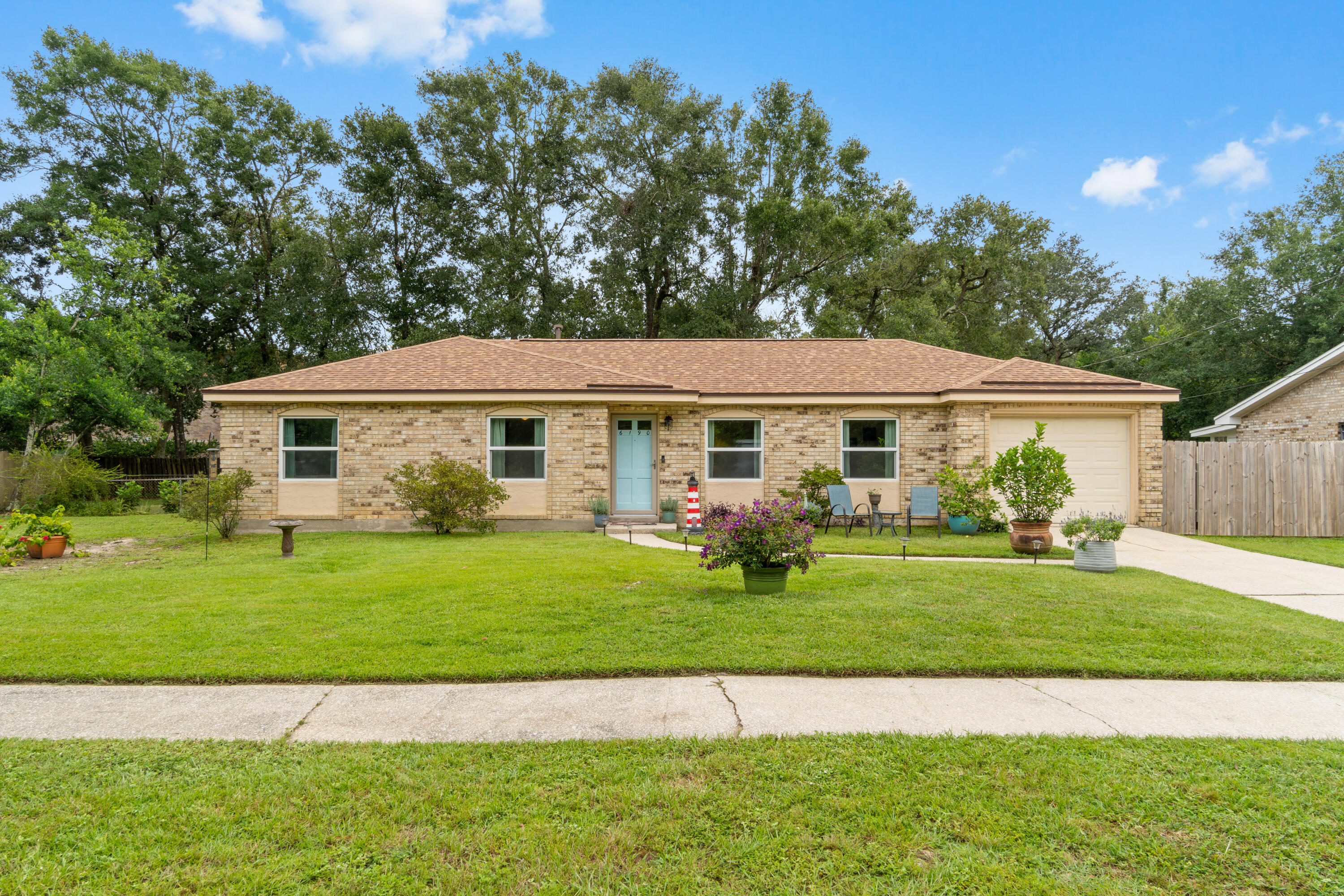 Perfectly located... this 3 bedroom, 2 bath all brick home is in the sidewalk neighborhood of Belved