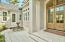 Private courtyard entry with fountain and custom 8ft. Mahogany Front Doors!