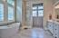 Large master bath with soaking tub and a separate, custom tiled shower