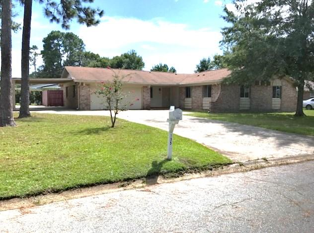 Need parking space? This is the home for you! Great 3/2 located in the heart of Niceville sits on a