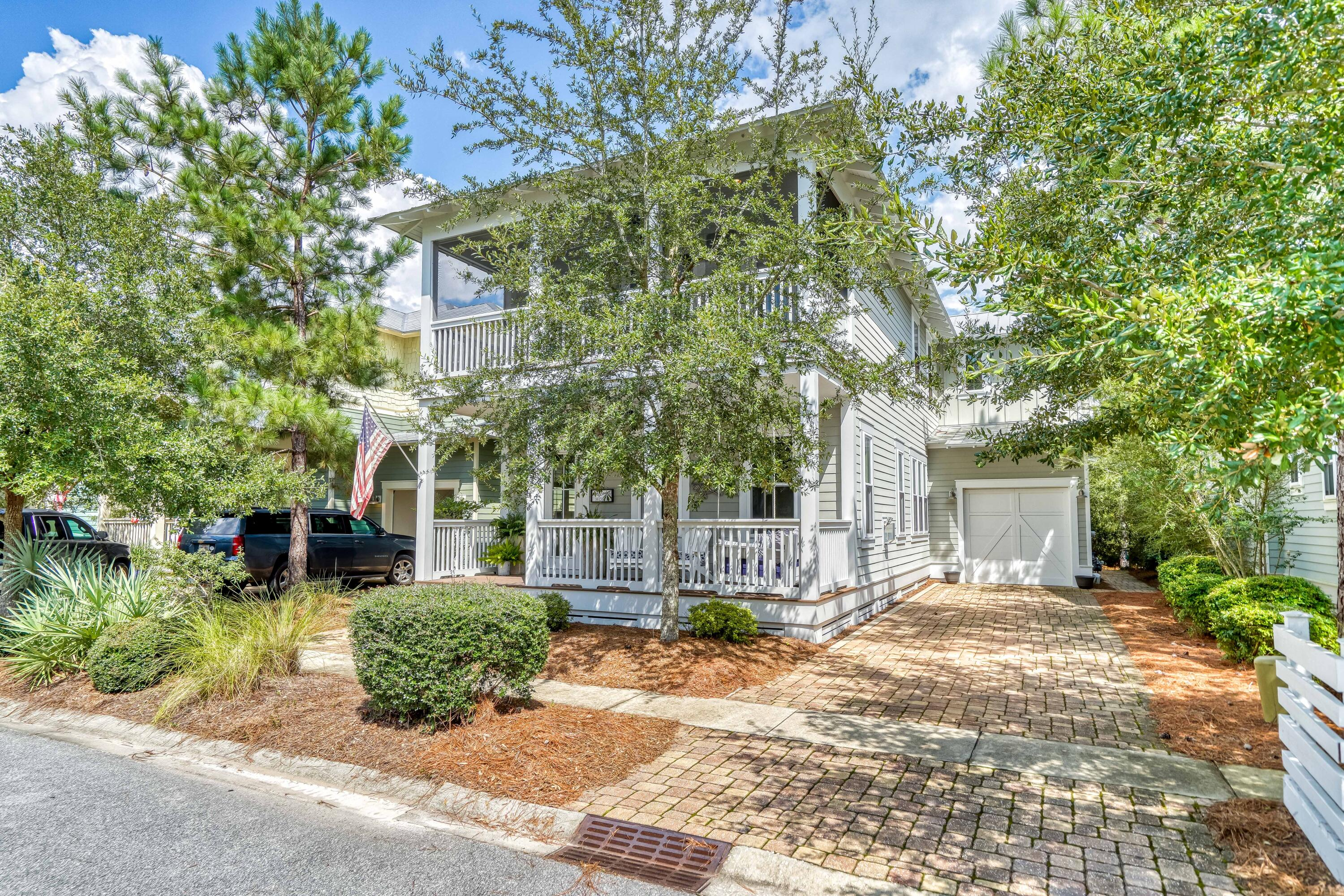 """Beautiful one-owner home on a quiet dead-end street in the NatureWalk community which is conveniently located less than a mile from Seaside, Watercolor, multiple beach accesses, restaurants, grocery stores, and much more. This home has been wonderfully maintained and cared-for and it shows immediately as you step foot onto the front porch which is remarkably cozy and the perfect spot for drinking your morning coffee or winding down those 30A days. When you enter the home you're met with abundant light from the many windows which creates an open spacious feel and there are quality finishes around every corner from coffered ceilings and a custom fireplace in the living room to the vertical shiplap accent walls that continue throughout. The living area flows into the dining room and then into an oversized kitchen which is equipped with all stainless steel appliances and granite countertops PLUS there's a 2nd sitting room/TV room just off the kitchen area.   This wide-open floor plan has tons of downstairs square footage and is excellent for entertaining and hosting multiple families.   Out the back door the home backs up to a wooded preserve that is exceptionally private and has a screened-in porch complete with an outdoor storage closet and an outdoor shower.  As we make our way upstairs there are 4 total bedrooms, 3 that have access to screened-in porches, and 2 with ensuite baths.   The master is very spacious and has a large master bath with soaking tub and separate walk-in shower and has a private porch that's screened-in and overlooks the wooded preserve area.   Other wonderful features are an attached garage that's perfect for a golf cart, and the golf cart IS INCLUDED with the sale of the home!  The amenities in NatureWalk are absolutely top-notch from the """"Gathering Place"""" with its zero entry pools, heated lap pool, hot tub, hammocks, fire pits, and social gathering areas to the many miles of nature trails including one directly to the beach.   There are also """