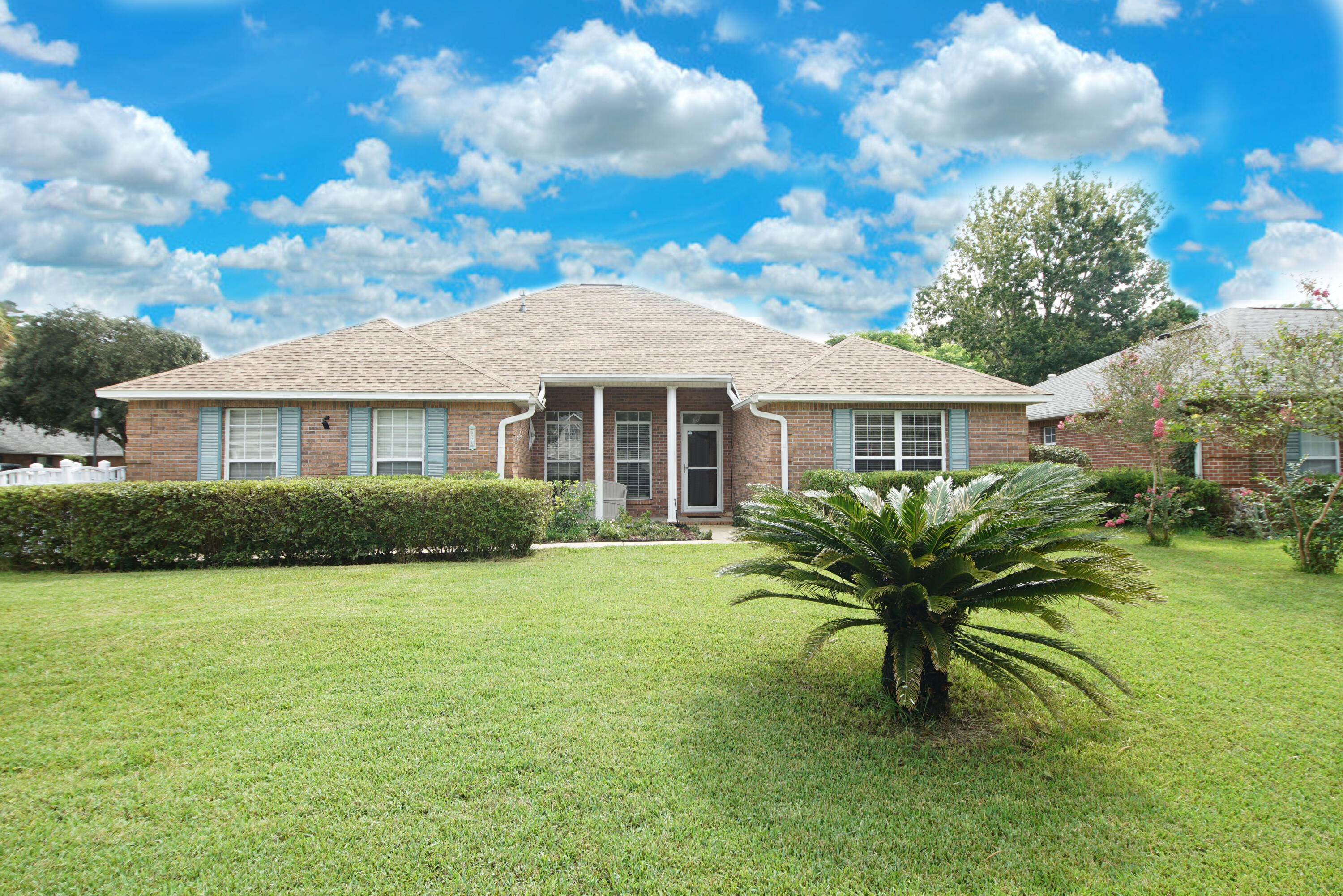 This lovely 4 bedroom home is located  in the highly desirable gated community of Parkwood Estates down the street from Bluewater Elementary School. It is also conveniently located to shopping and just a short drive to the beautiful Destin beaches.  Split bedroom floor plan with Master on one side and three additional bedrooms on the other.  One of the additional bedrooms is located in the front of the home and could also be used as an office.  The other two bedrooms are on the other end with a bathroom in between. Spacious Master bedroom with a walk-in closet and Master bath with dual vanity sinks, garden tub and separate shower. Australian cypress wood throughout the main living areas and in the Master bedroom, carpet in additional bedrooms, tile in bathrooms and laundry room, cozy