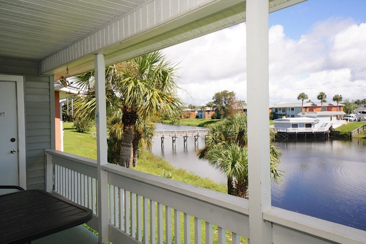 One of the lowest priced condos in Destin - Centrally located & close to the Gulf - Beautiful low density Community with Lakes/3 Pools/Tennis Courts & 2 Gated Entrances. This bright 2nd floor, 1 bedroom unit, overlooking the Lake is positioned between 2 Community Pools: one next door & one across the lake bridge. Large balcony with table & chairs overlooks the lake. Laundry/storage room, located off balcony, has stackable washer/dryer. Spacious living room with 2 sliding glass doors allows views of the Lake & adds natural light. Kitchen is partially open to the living room & has plenty of storage. The condo offers options to own as a primary home/second home/ or long term rental or vacation rental investment. Storage Rental Space for Boat available $25 month. Don't miss out on this one!