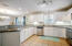 Large Kitchen with Stainless Appliances, Newly Repainted Cabinetry, Abundant Storage & Counterspaces