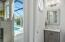 Powder bath with access to the pool and outdoor living space