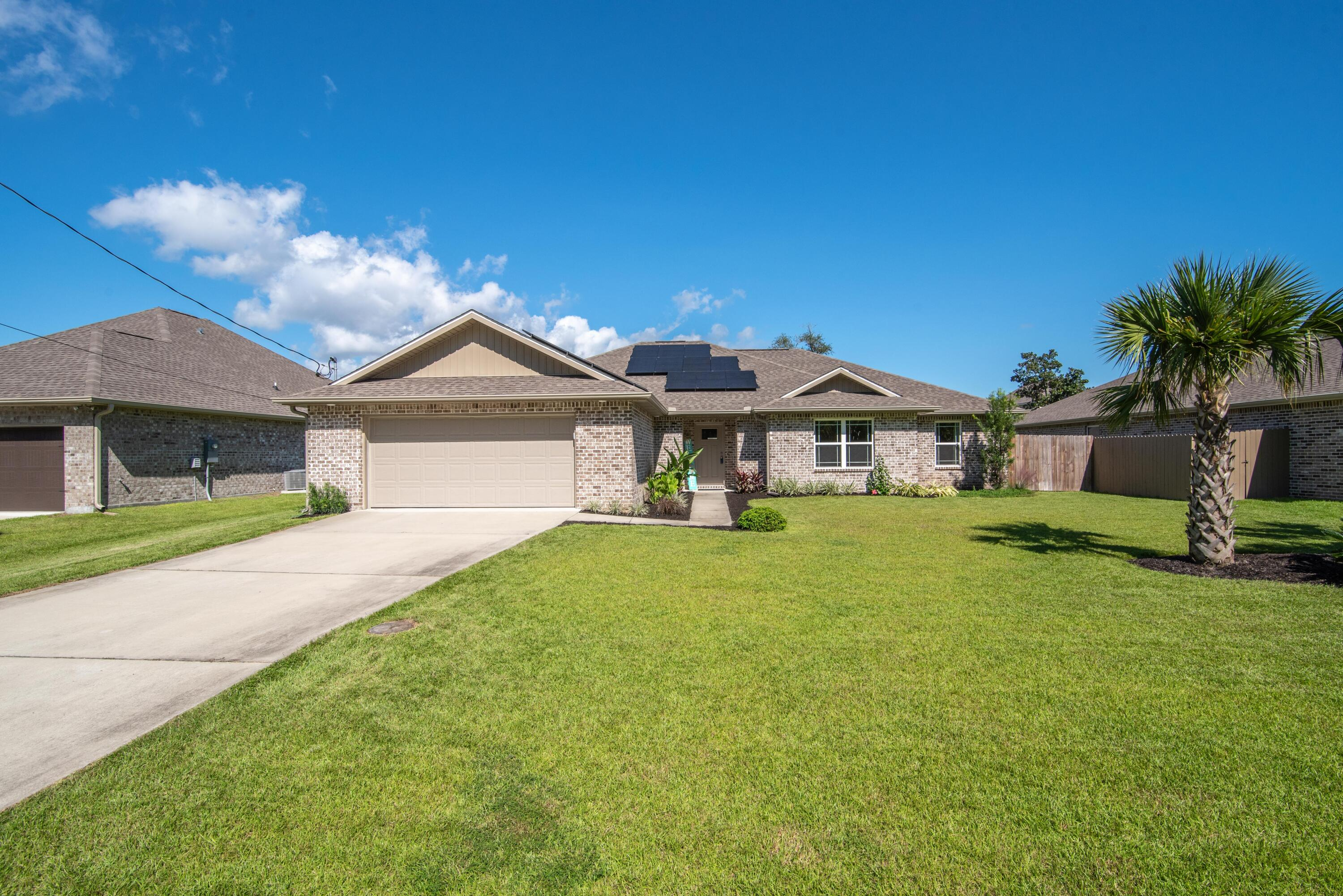 Built in 2018, this perfectly maintained home offers a BRAND NEW saltwater swimming pool with a covered patio, an open spacious floor plan with vaulted ceilings making the perfect space to entertain guests. You'll rest easy with Kevlar hurricane coverings, termite bond and RING doorbell. The kitchen comes equipped with stainless steel appliances, granite countertops, fridge with ice and water dispenser, built-in microwave with an electric cooktop. You'll also enjoy the large island providing seating for 4 and the over-sized pantry providing ample storage. The spacious primary suite has a tray ceiling and the bathroom has a double granite vanity with a large tiled walk-in shower, garden tub, water closet and dual walk-in closets with pocket doors. The 3 additional bedrooms are located on th