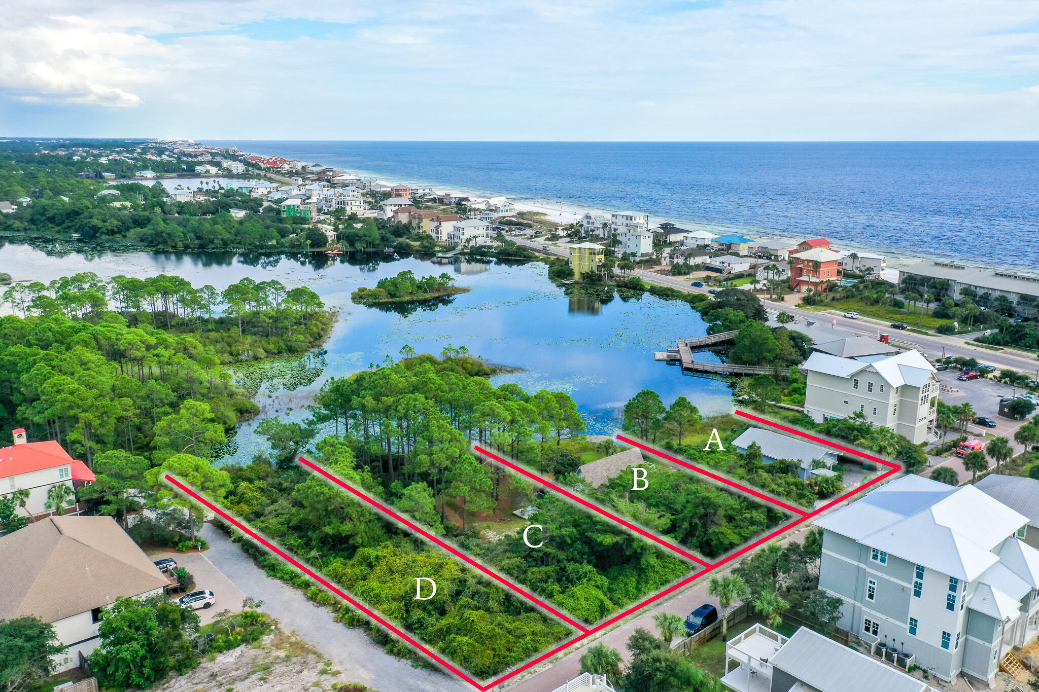 Fantastic development opportunity. 66 N Woodward has been replatted and is now home to FOUR LOTS. Located on Allen Lake and zoned Neighborhood Infill, this four lot development has endless development opportunities! Positioned 300ft from 30A's NEW Dune Allen Regional beach access and just 3 lots back from Stinkys Fish Camp, 30a's lakeside dinning and entertainment hot spot! Exceptional area for building vacation rentals or second homes.  The property currently has two homes that provide exceptional rental income.Buyer to verify all information and dimensions. Information is deemed reliable but not guaranteed. Information deemed reliable but not guaranteed, buyer to verify all dimensions.