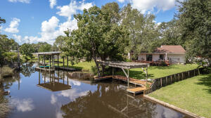 Enjoy fishing, paddle boarding, kayaking and boating from your backyard, with bay access from this serene canal.