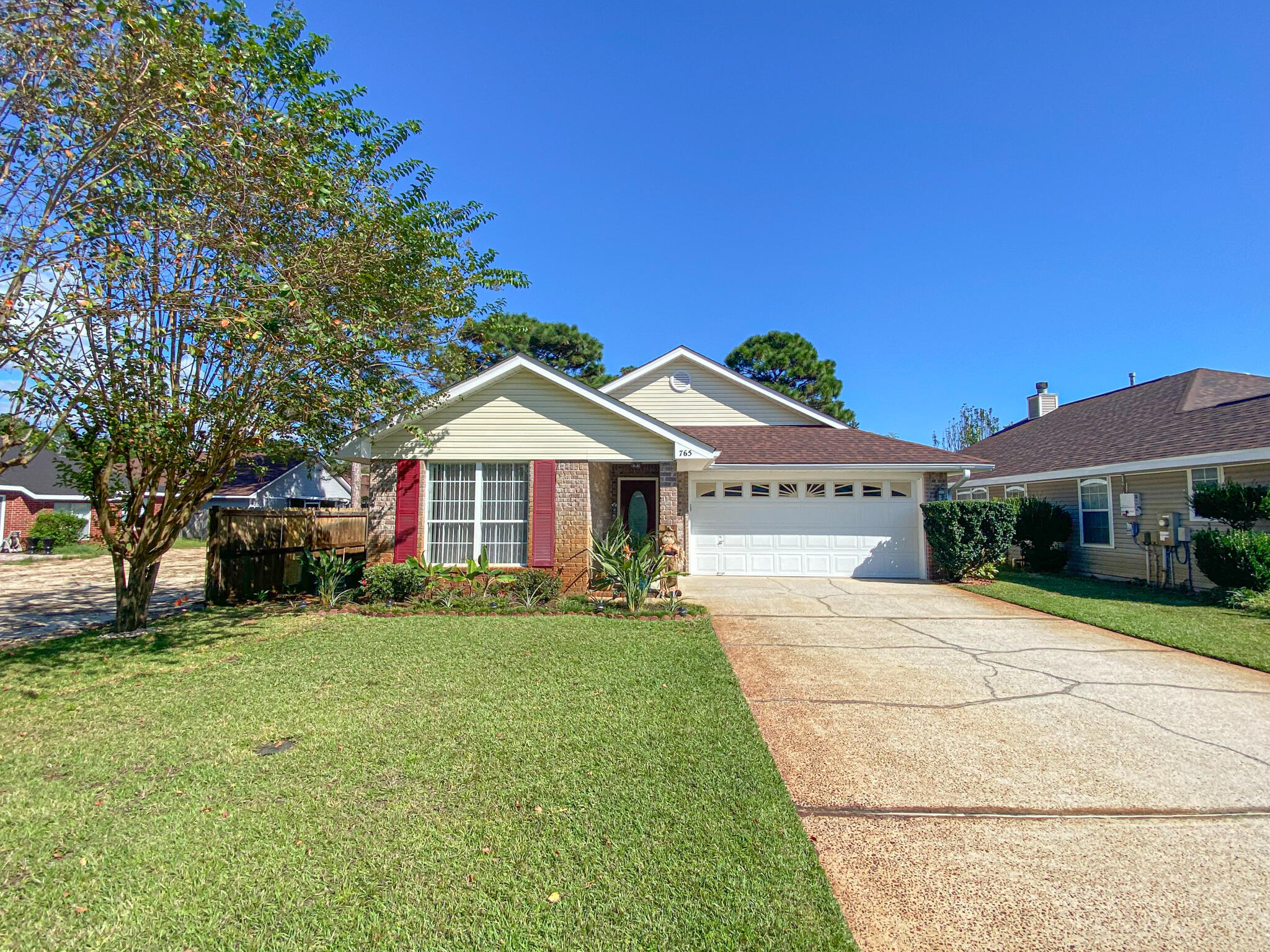 Home sweet home! This 3 bedroom 2 bath brick home in Emerald Village has been impeccably maintained