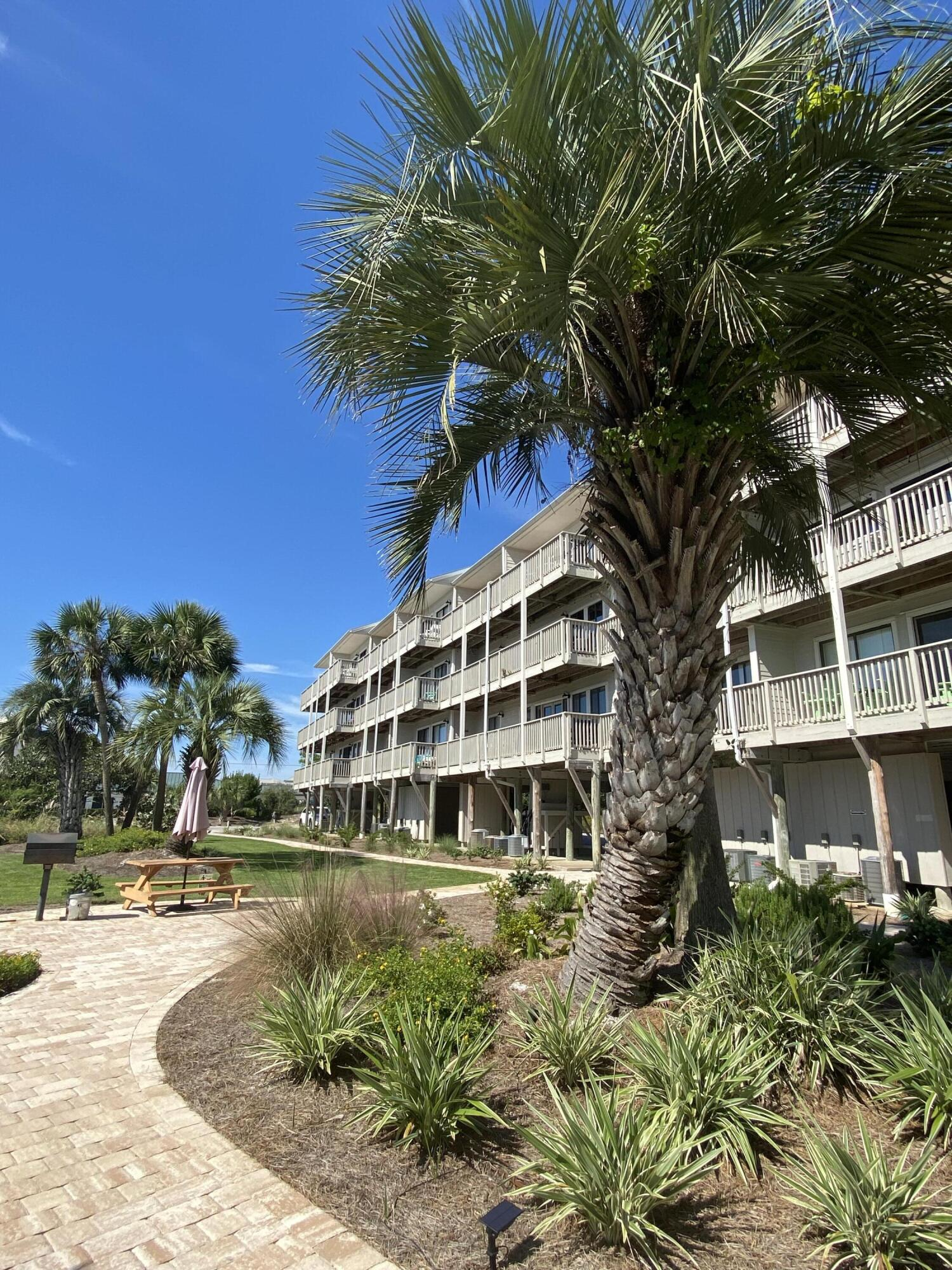 SOUTH OF 30A in Seagrove and JUST STEPS TO THE BEACH!  This cheerfully decorated studio condo sleeps 4 is fully furnished and ready to enjoy!  Private balcony looks out over Deer Lake bordering this community to one side while also overlooking the pool and beautiful emerald water just beyond!  Beachfront II is beautifully landscaped and has so much to offer including oversized heated pool and whirlpool area, covered deck/gazebo, grilling area, elevator, and covered parking.  They have recently completed a huge renovation to include new pool decking, new whirlpool, new metal roof, new hardy board siding and paint, new fire and safety equipment, new exterior lighting, and more!  This condo has not been on a rental program and has been meticulously maintained.  Must see!