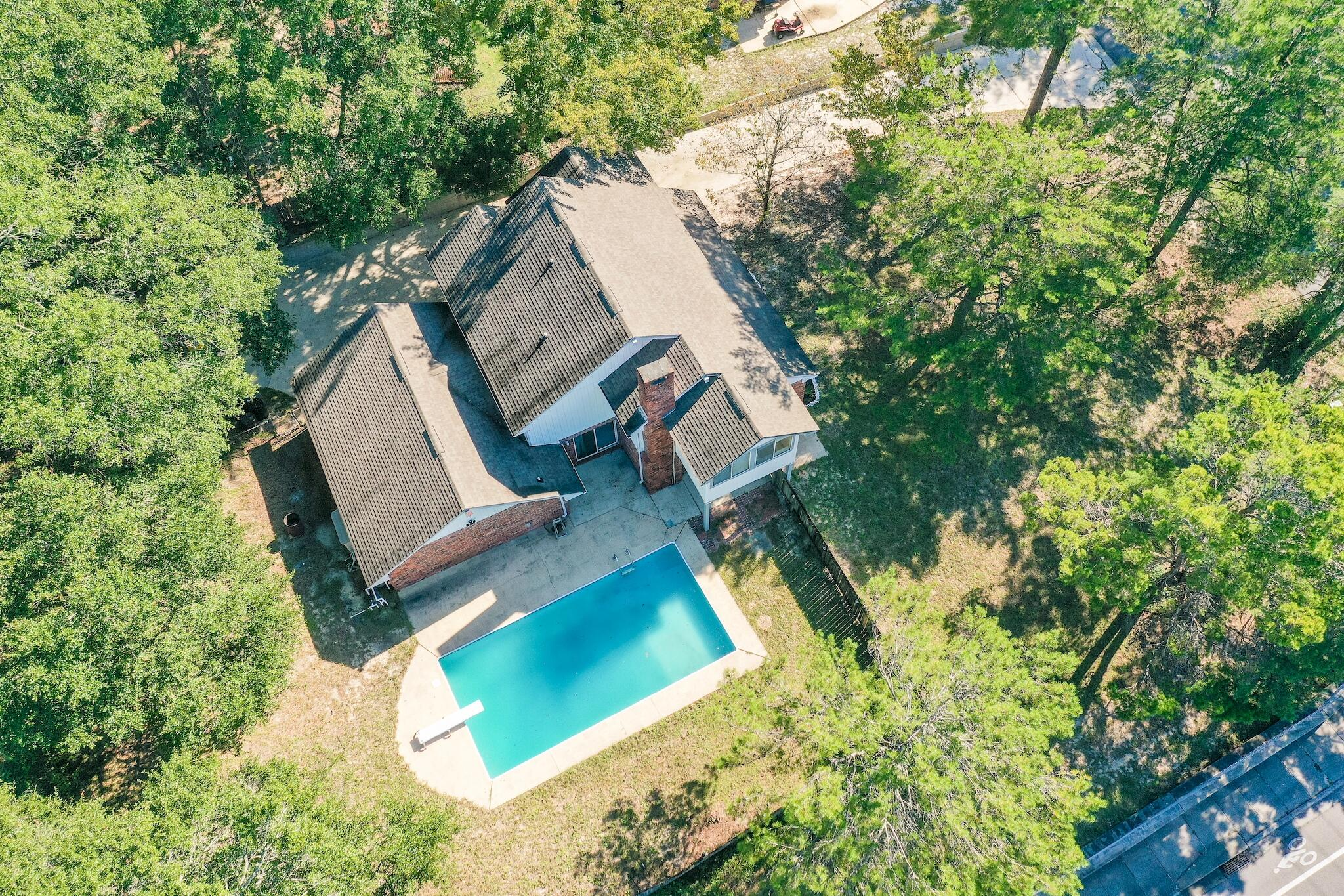 Nestled on nearly half an acre this residence is located in the desirable Rocky Bayou community, fea