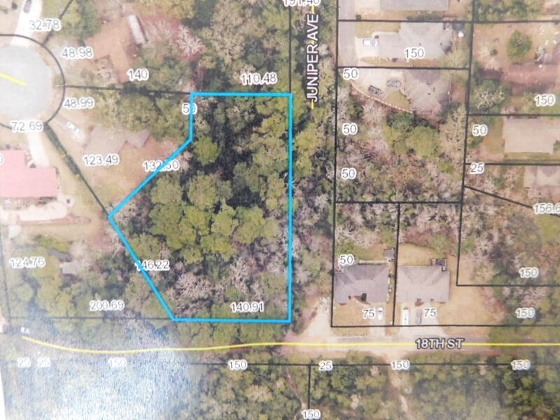 his .96 of an acre, wooded parcel is located in the heart of Niceville and close to all shopping, di