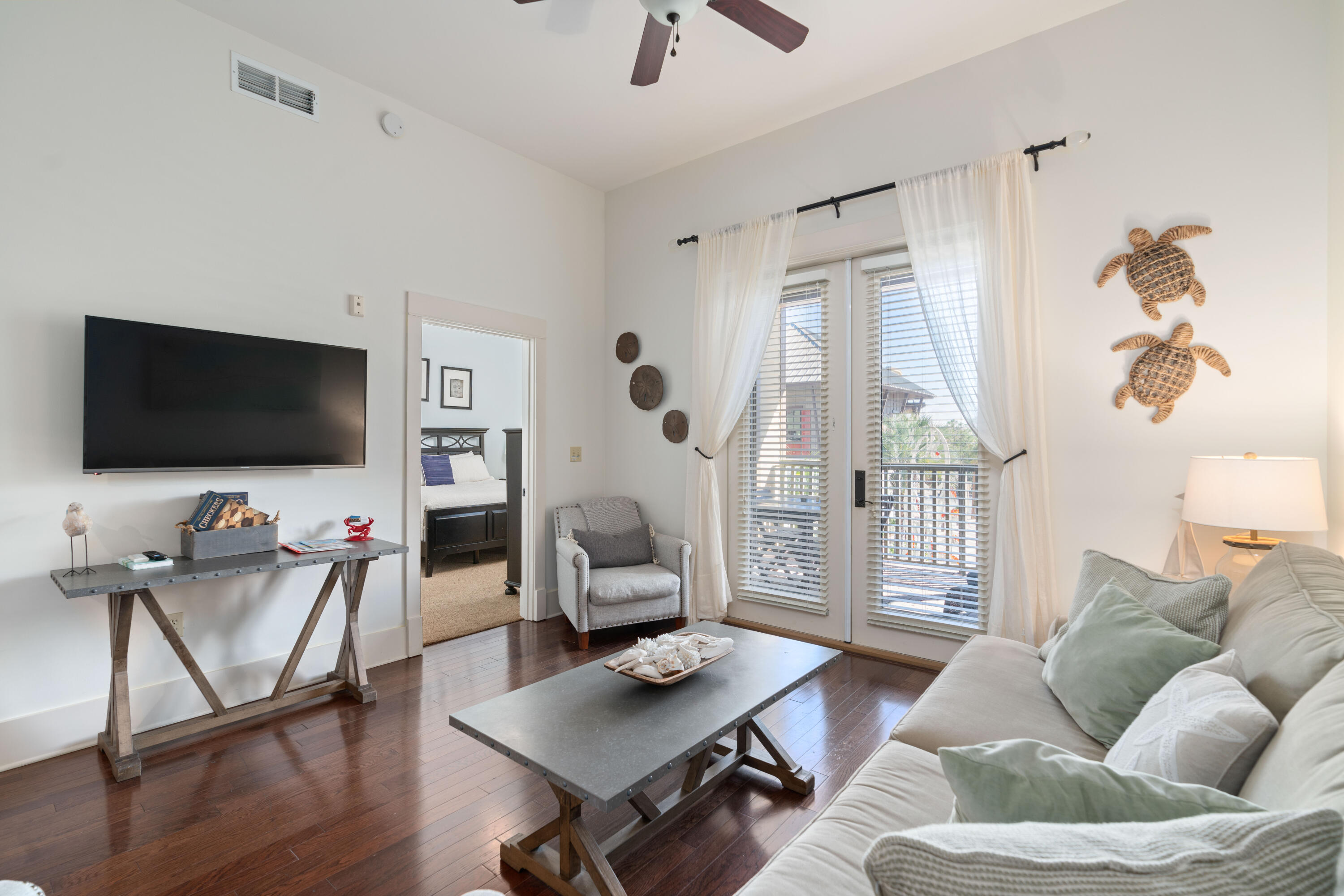 Amazing opportunity to own a vacation property located in Redfish Village in the Blue Mountain Beach area of 30A.This upscale unit features beautiful hardwood floors, granite counter tops, stainless steel appliances, spacious dual access balcony, and an assigned covered parking space. Redfish has its own private beach access, year-round shuttle service, men's and lady's cabana restrooms and showers. Redfish Village amenities are some of the finest on 30A and include an owner's only private access to the white sandy beaches, private owner's lounge with a sunlit reading room, landscaped pool area, media/theater room, fully stocked library, and children's play garden. Unit currently is a vacation rental property that comes fully furnished with some owner exclusions.