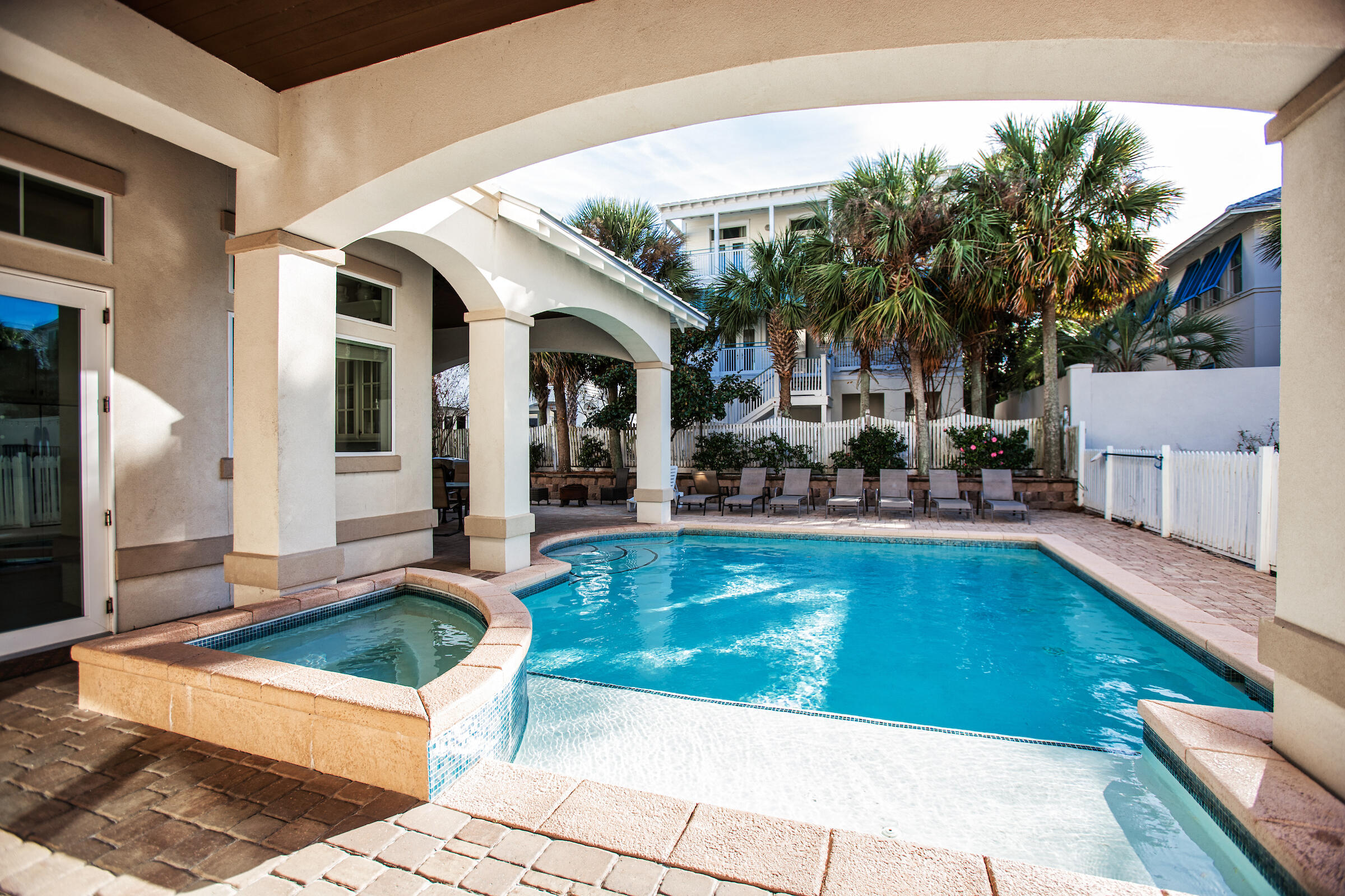 Stunning 3 story Mediterranean style home with private pool only a 2 minute walk to the private beac