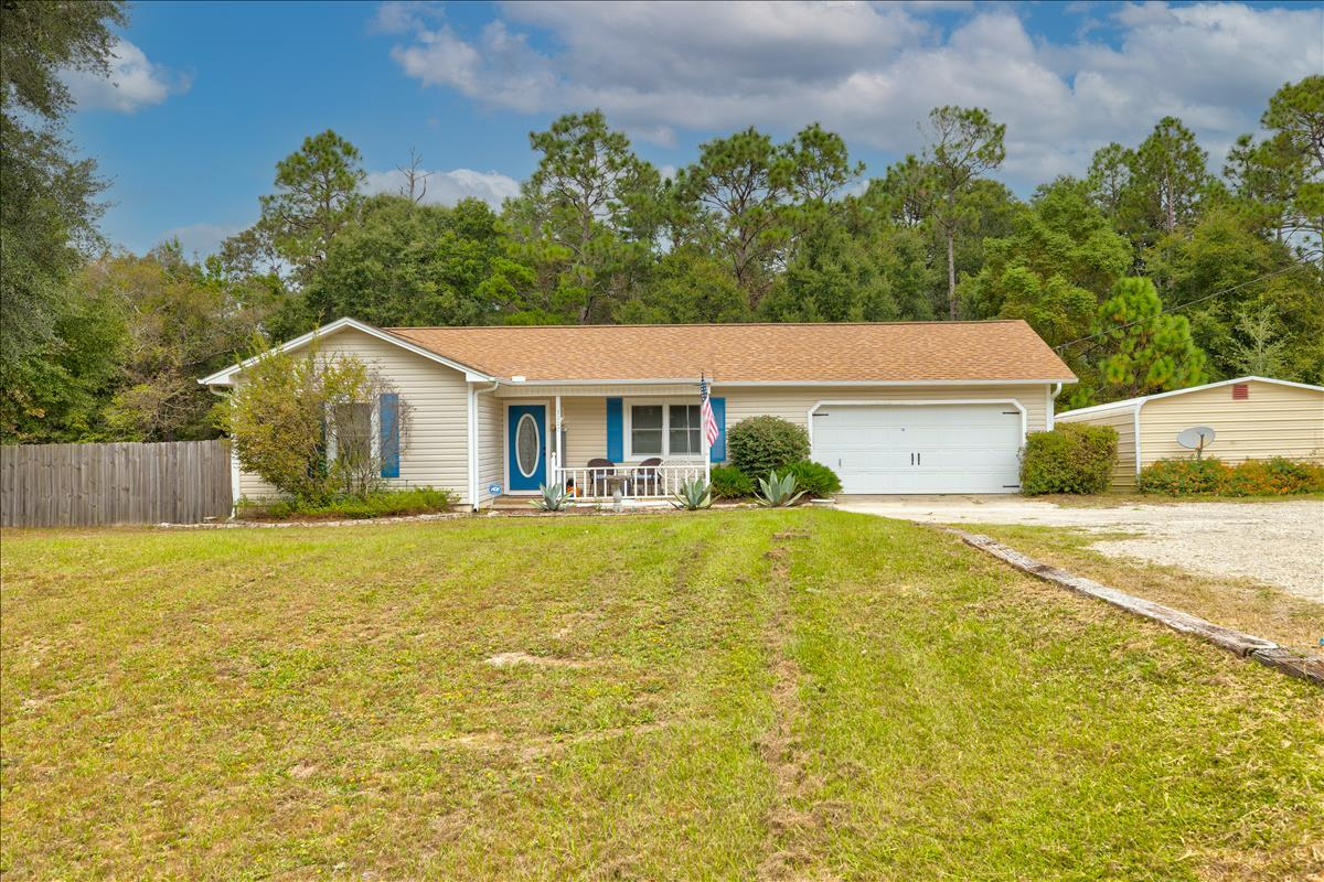 More photos coming soon! This beautiful home is on nearly a half acre of land and situated just minu