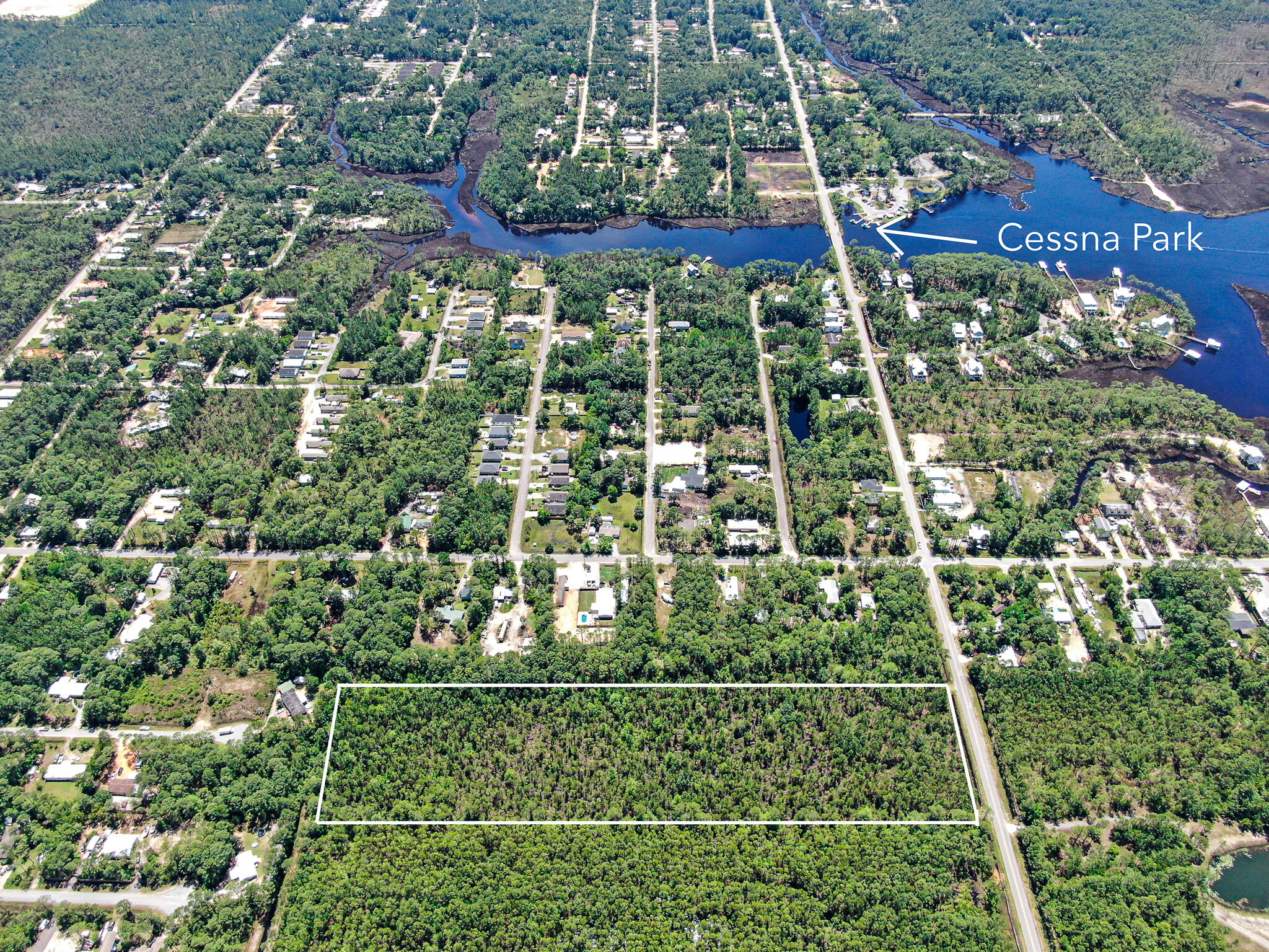 This 9.75 acre tract of wooded land has 330' of frontage on Hwy 393 North that is less than a mile to the Choctahatchee Bay.  Property has uplands and some wetlands to the rear.  Great opportunity for development and currently zoned Conservation/Residential, but potential for low density dwellings with zoning and land use change.  Buyer to verify lot dimensions, restrictions, utilities and zoning requirements.